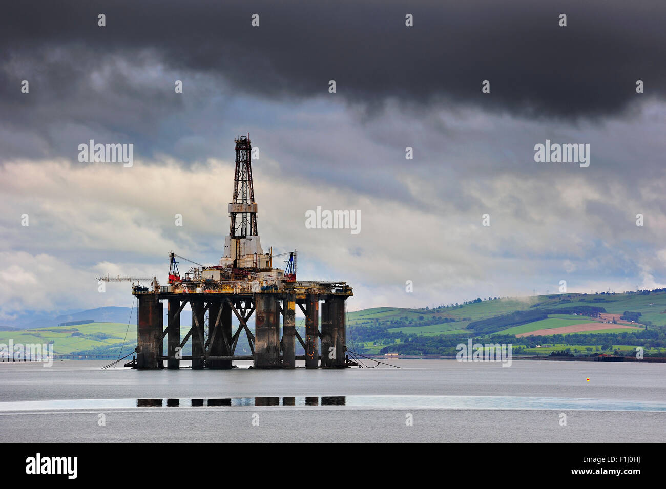 Oil rig / oil drilling platform waiting to be repaired in Cromarty Firth near Invergordon, Ross and Cromarty, Scotland, UK Stock Photo
