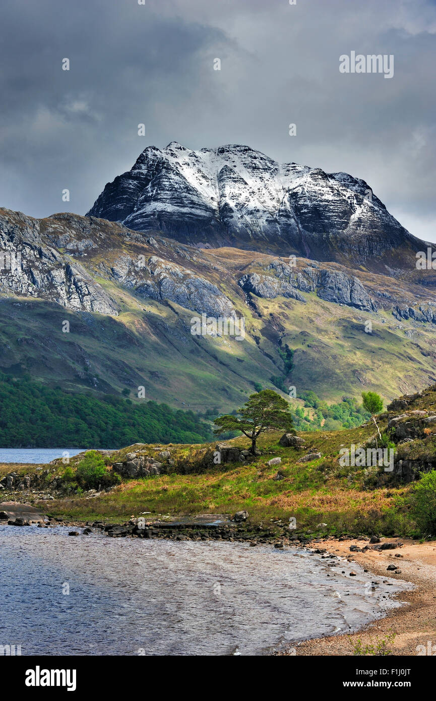 Loch Maree and the mountain Slioch covered in snow in spring, Wester Ross, Scottish Highlands, Scotland, UK - Stock Image