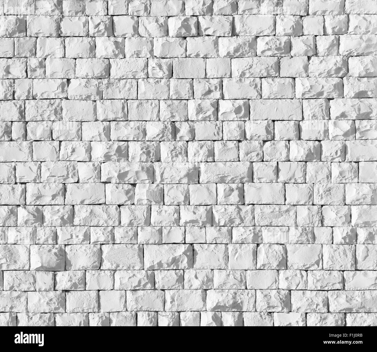 Background of white stone wall texture - Stock Image