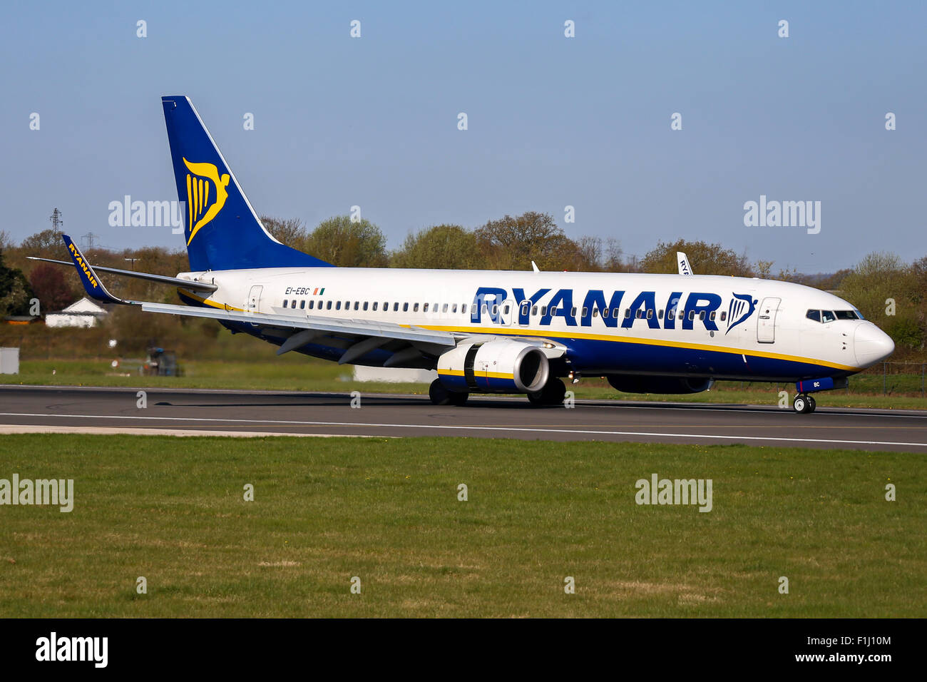 Ryanair Boeing 737-800 touches down on runway 05L at Manchester airport. - Stock Image