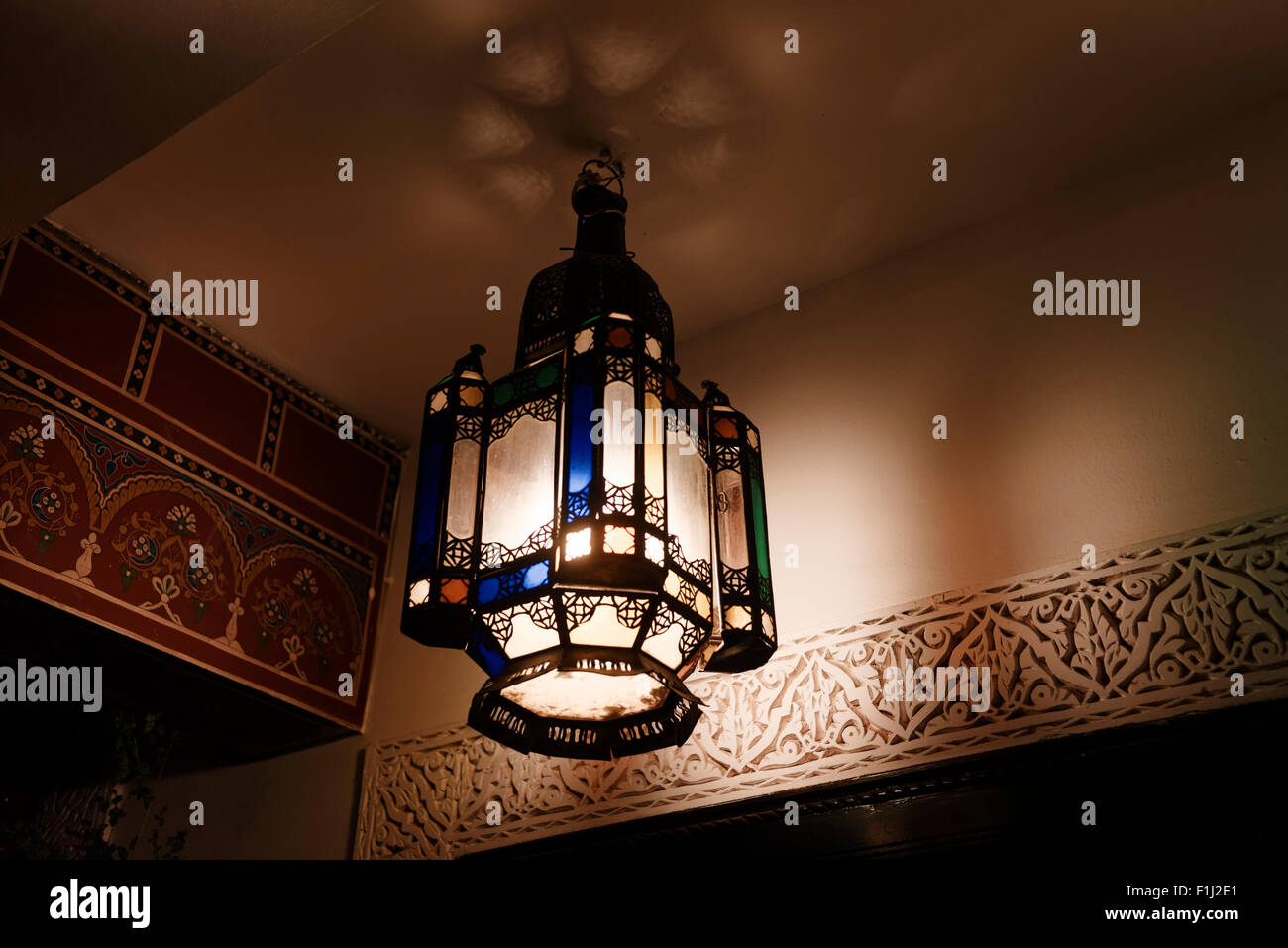 Traditional moroccan african lamp shade lampshade handing in a stock traditional moroccan african lamp shade lampshade handing in a marrakesh room with designed wall lit illuminated night mozeypictures Image collections
