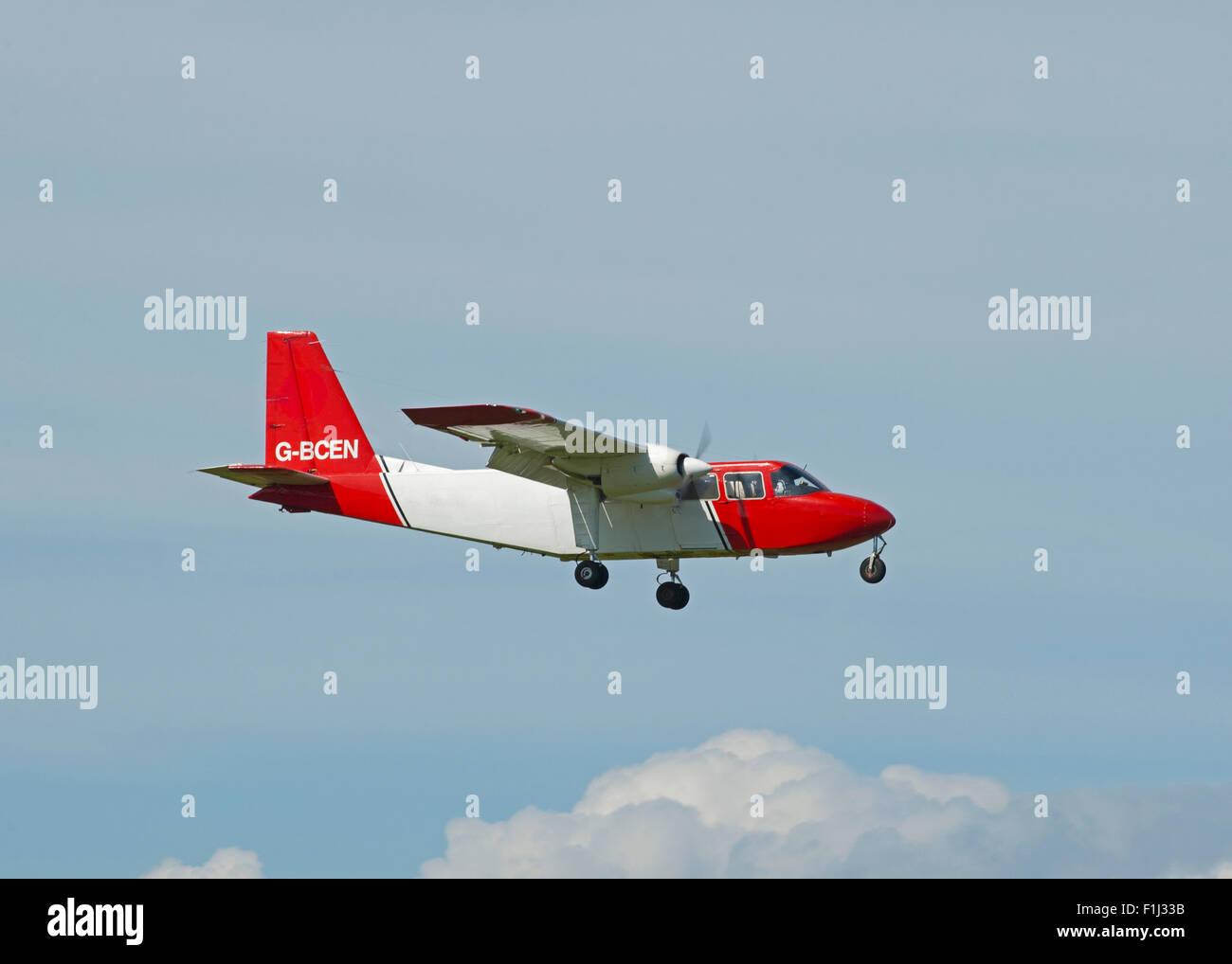 Britten Norman BN-2A-26 Islander (G-BCEN) approaching Inverness Airport. SCO 10,070. - Stock Image