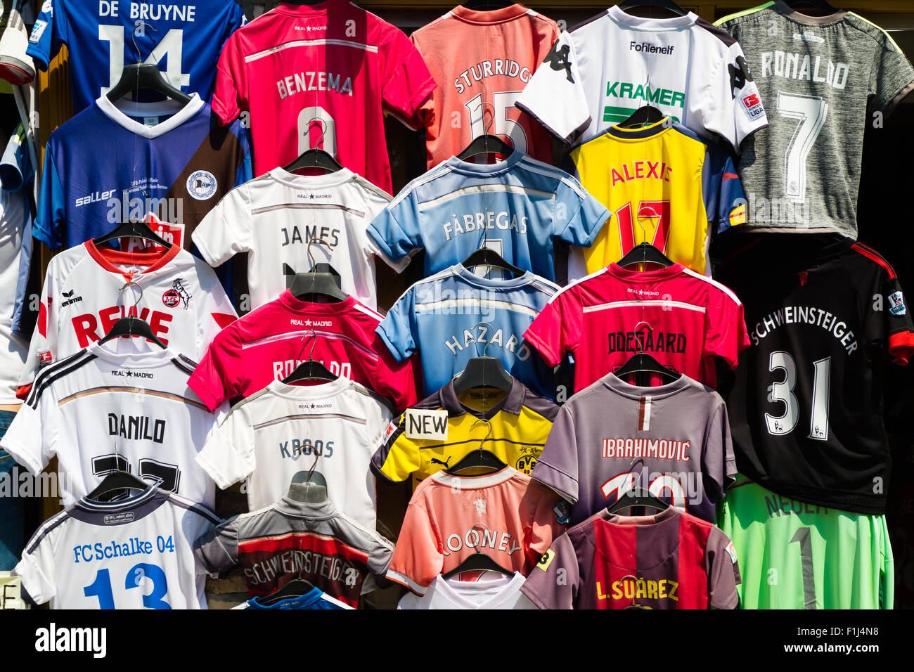 Replica football shirts hang outside a shop Stock Photo  87065364 ... 614ebbfdd87c