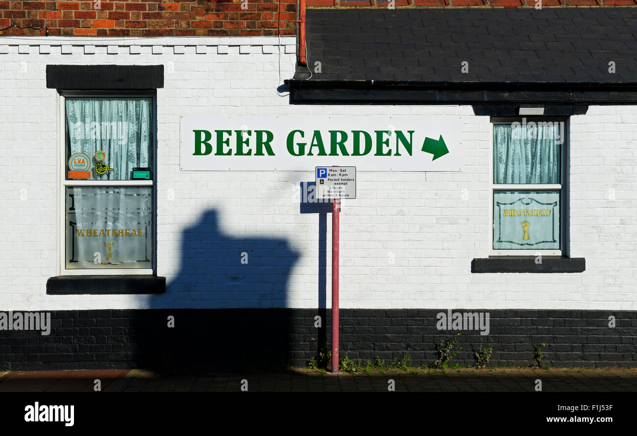 Sign - Beer garden - on wall of pub, England UK - Stock Image