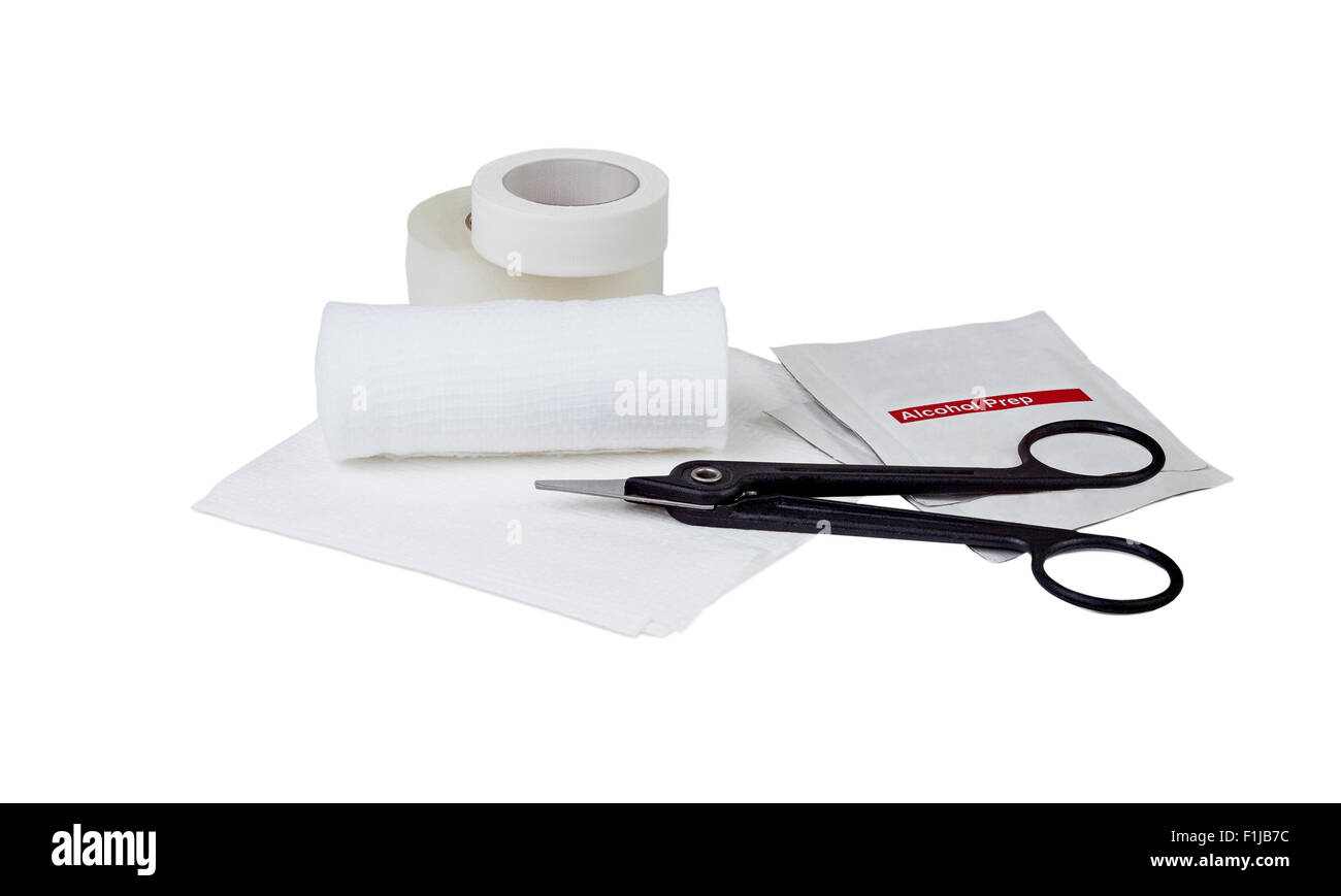 White gauze bandage roll and pad with alcohol prep wipes, medical scissors and medical tape - Stock Image