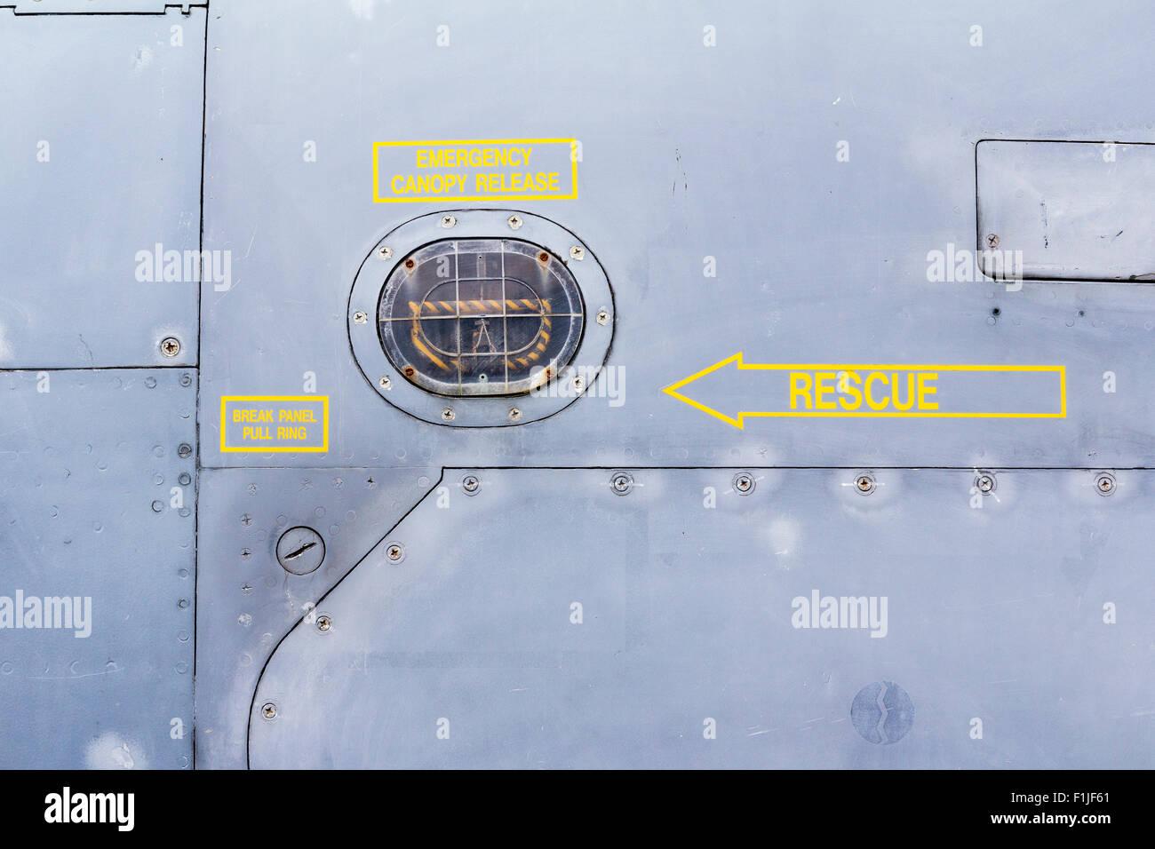 England, Manston airport museum. British Jaguar Fighter, rescue signs near cockpit - Stock Image