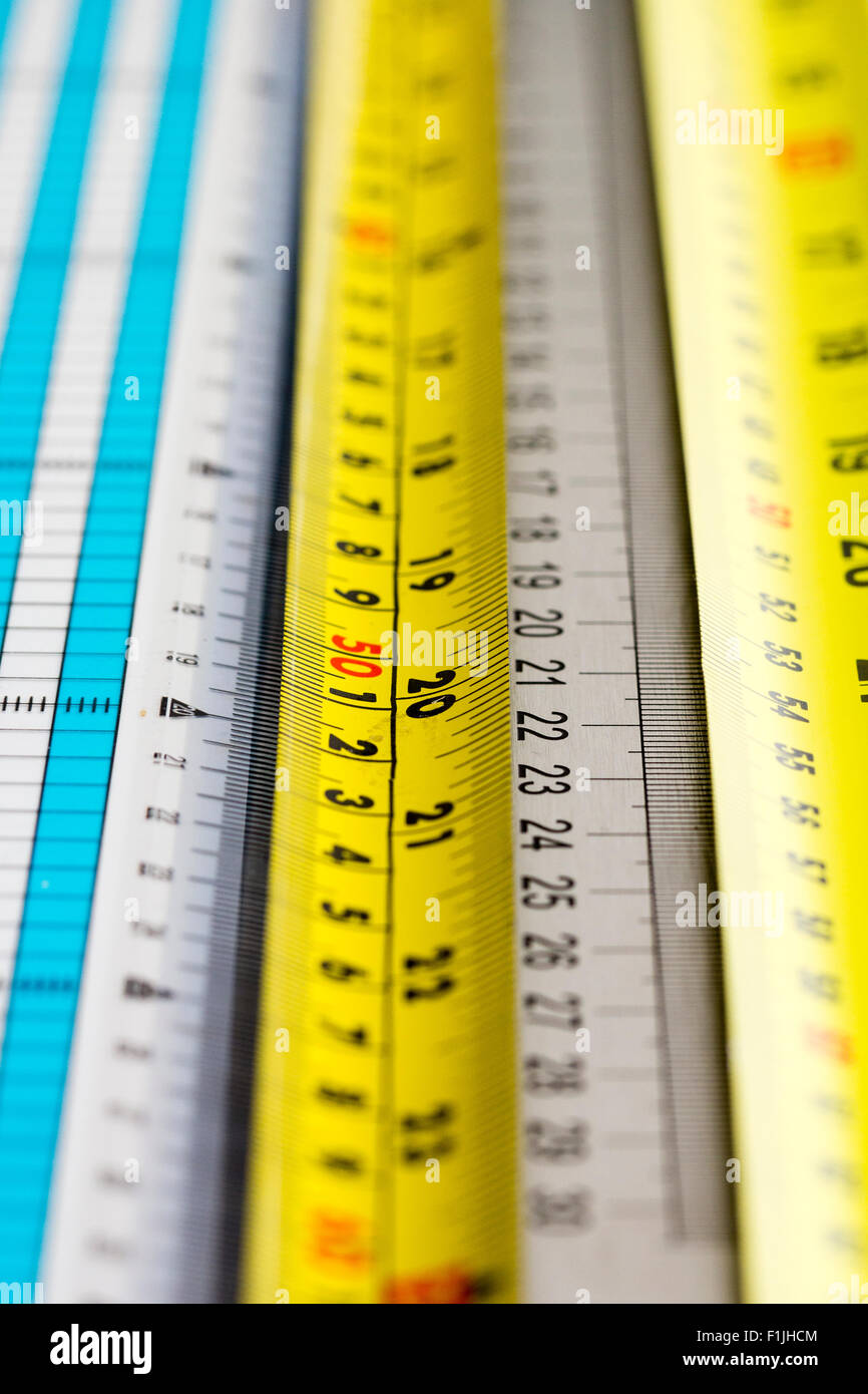 Rulers. View along various rulers and tape measures, yellow, white, blue Stock Photo