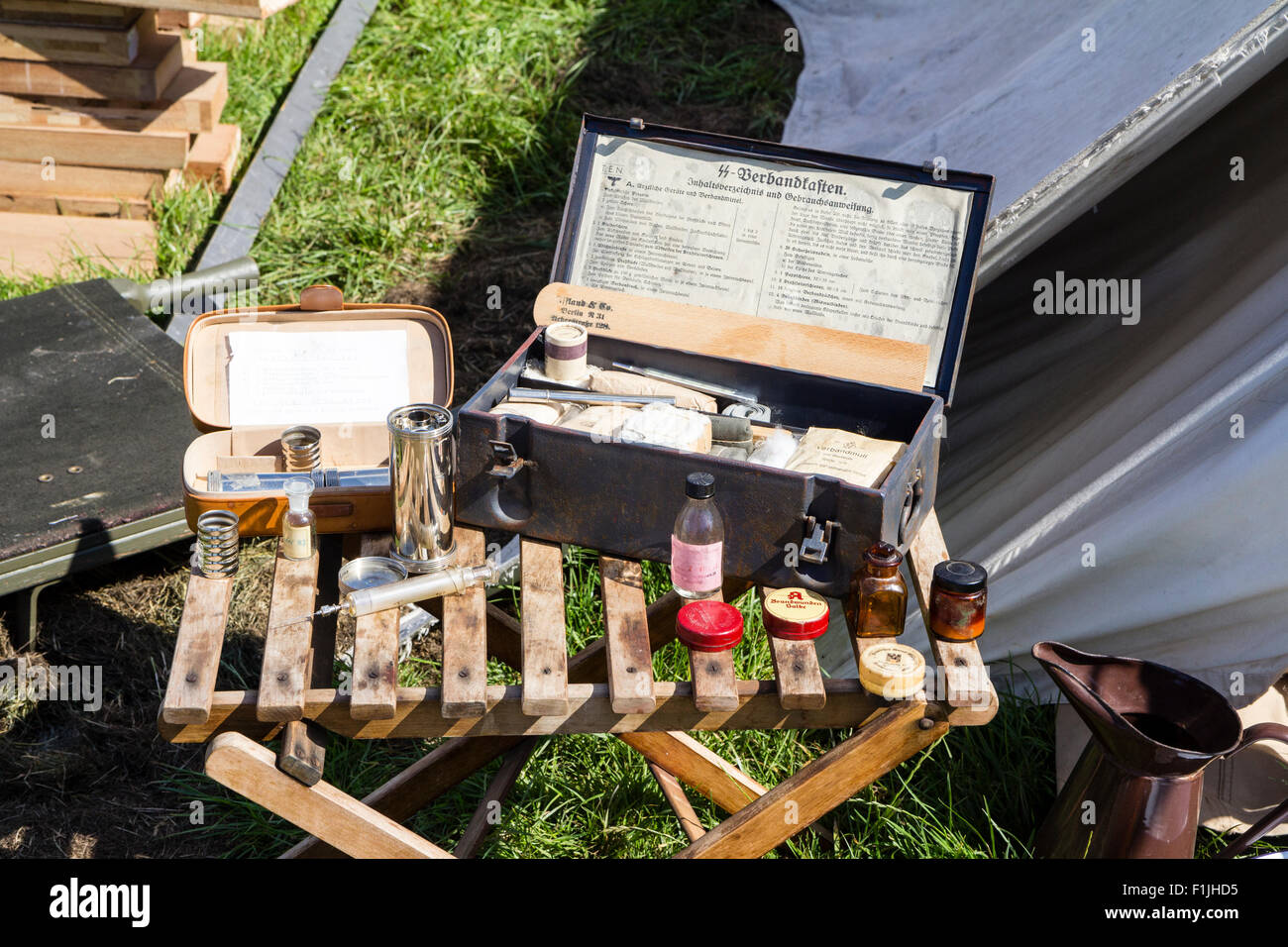 Re-enactment. World war two, German Waffen SS first aid post, medical supplies laid on on chair and on stretcher - Stock Image