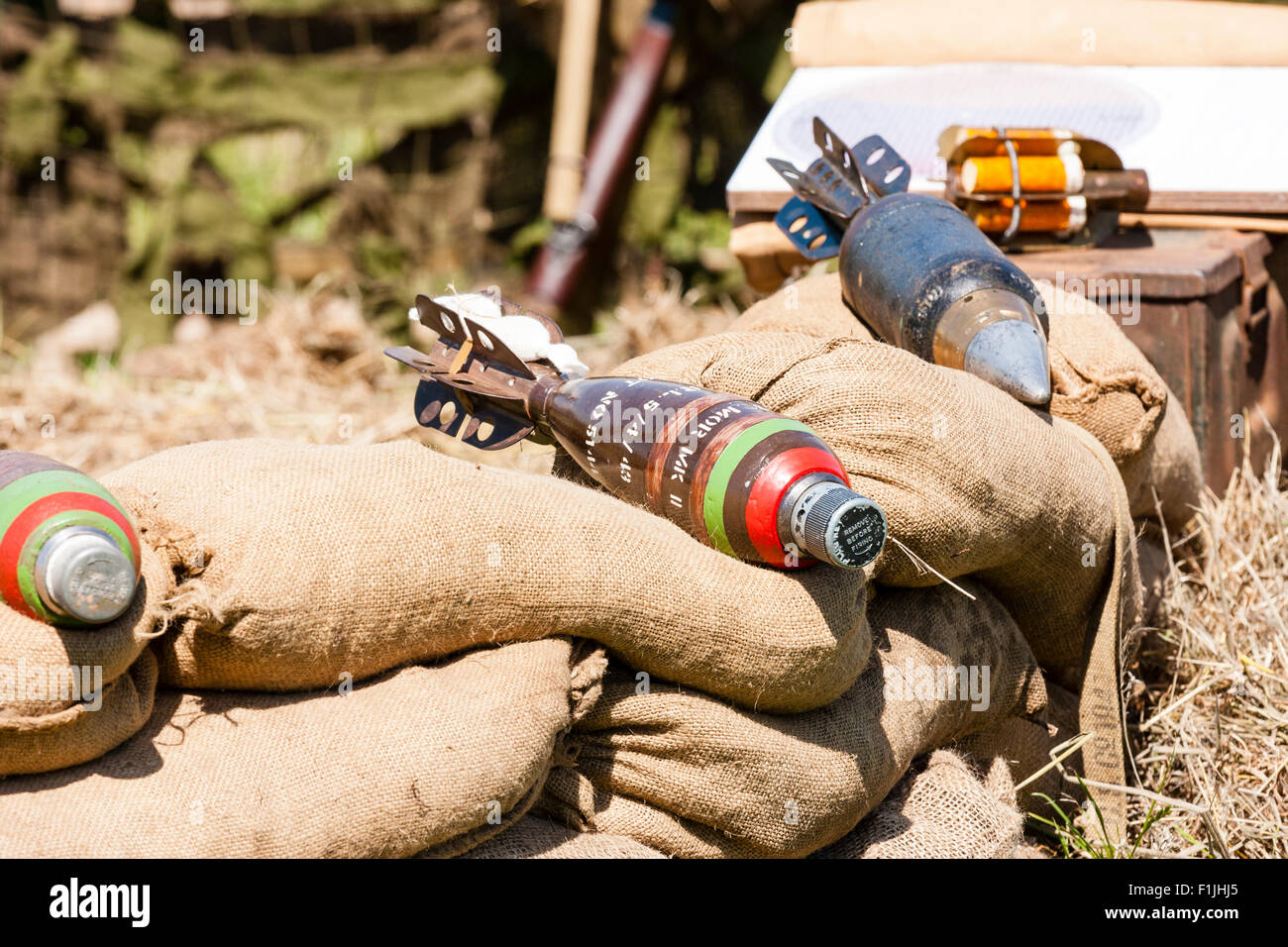 Second world war re-enactment. British types of 3 inch mortar bombs, mark 2, laying on sandbags - Stock Image