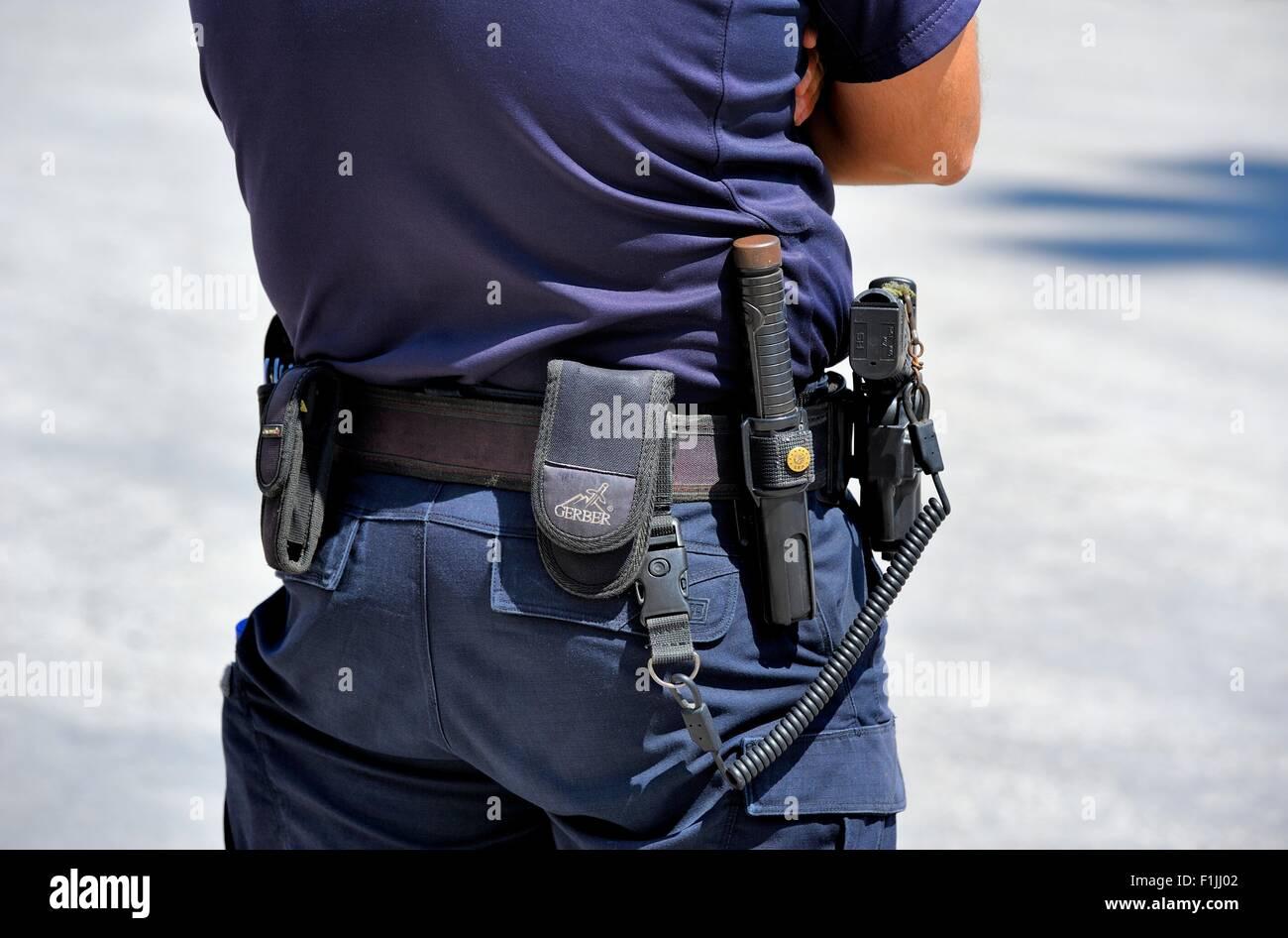 Port of authority policeman at the port of Ormos Athinios Santorini Greece - Stock Image
