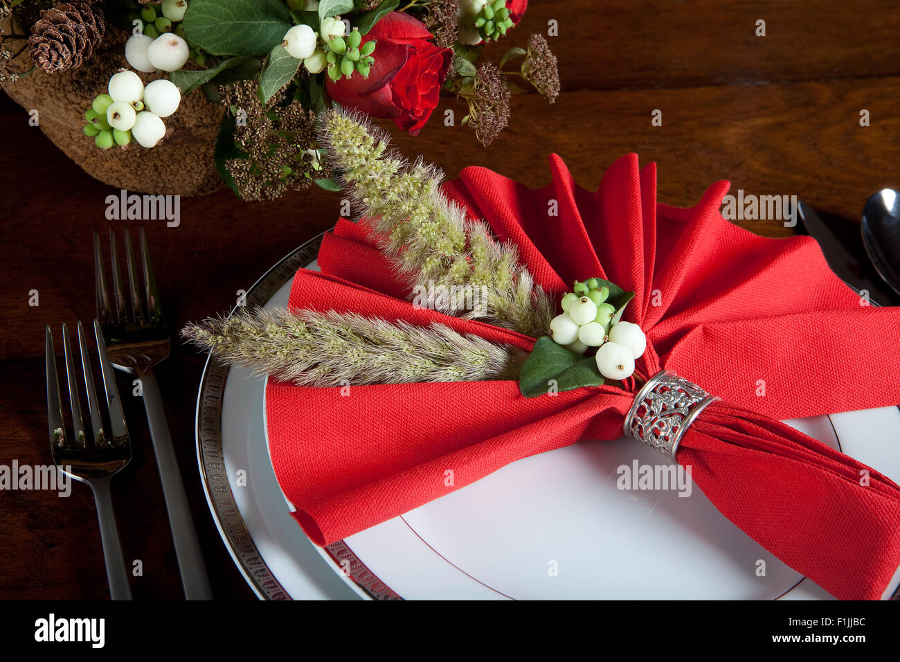 Festive Red Decorated Napkin With Ornate Sterling Silver Napkin Ring