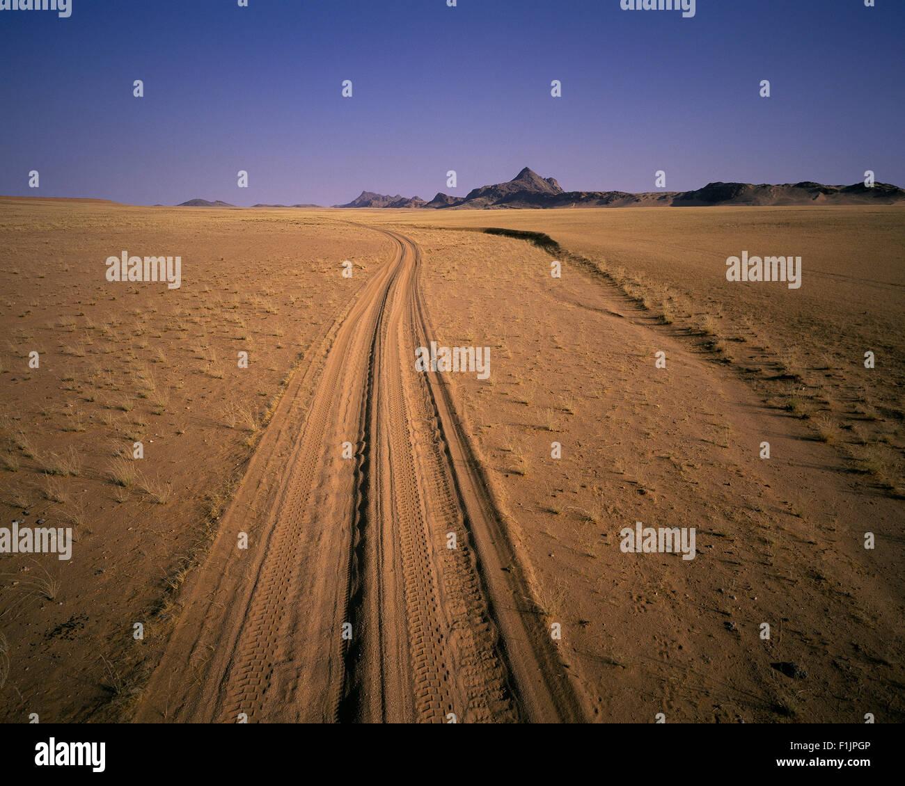 Tire Tracks in Sand Skeleton Coast, Namibia, Africa - Stock Image