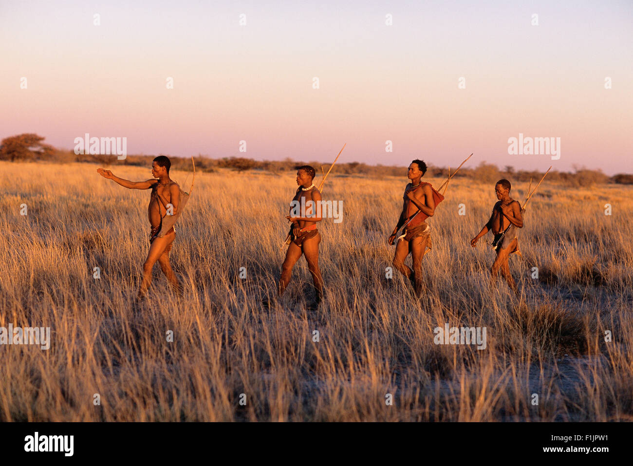 Bushmen Hunting at Dusk, Namibia, Africa - Stock Image