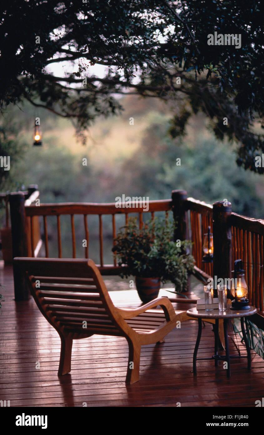 Deck Chair Balcony Overlooking Trees - Stock Image