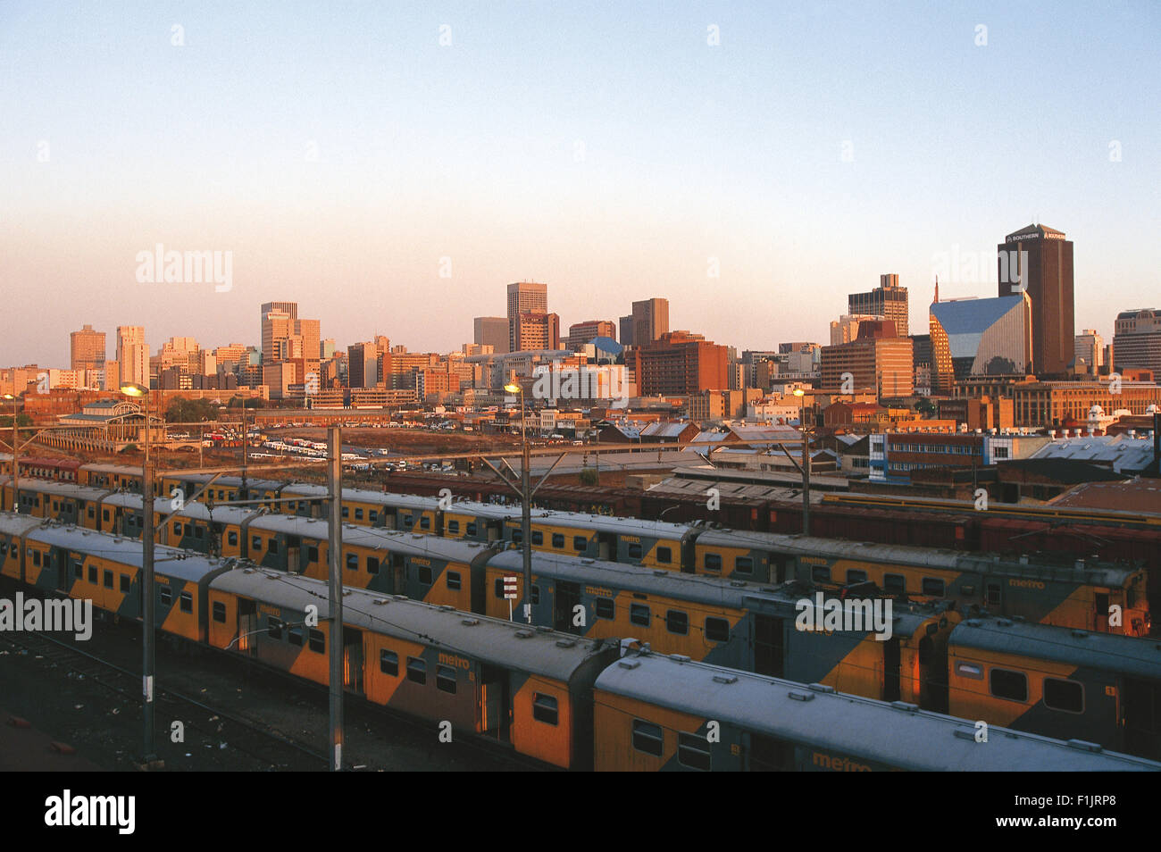 Johannesburg skyline with trains and railway station in foreground. Johannesburg, Gauteng Province, South Africa, - Stock Image