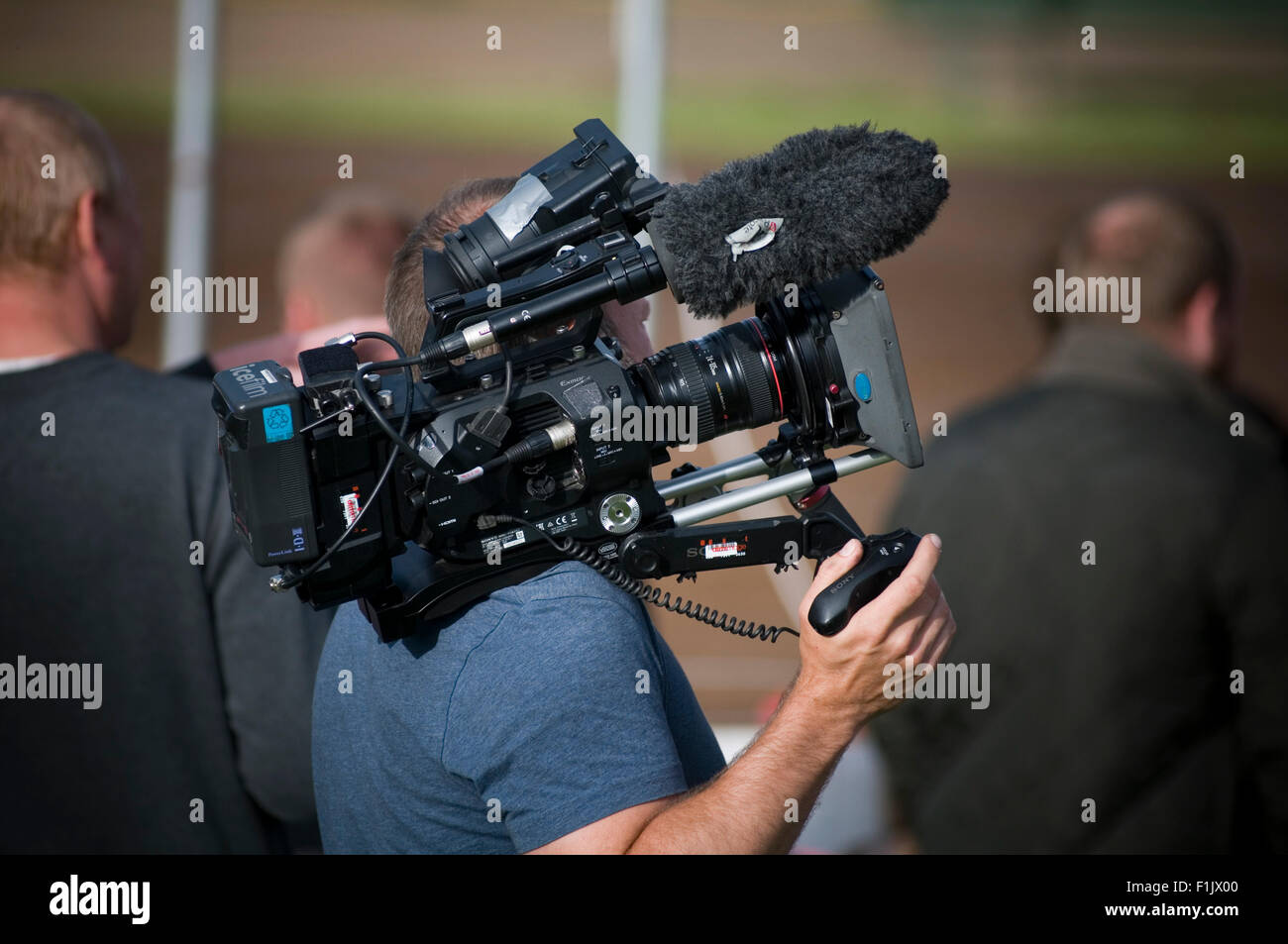 broadcast video camera man men cameraman cameramen digital tv  production company television outside broadcast broadcasting - Stock Image