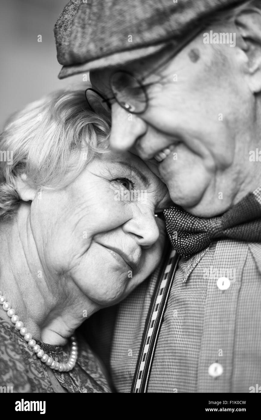 Portrait of affectionate retired couple - Stock Image
