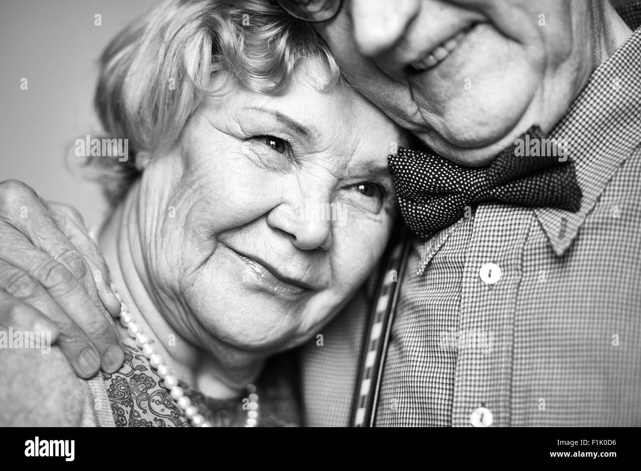 Affectionate senior woman close to her husband - Stock Image