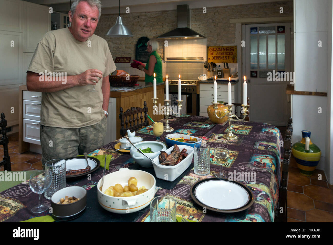Chef in a traditional dining room, French country house, Gourville, Charente Maritime, France - Stock Image