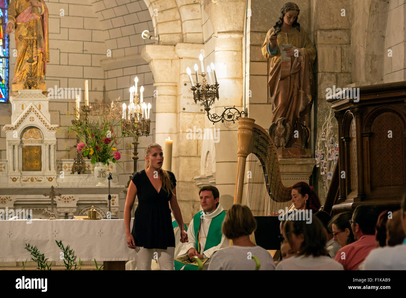 Recital at the church of St. Cybardeaux, Charente Maritime, south west France - Stock Image
