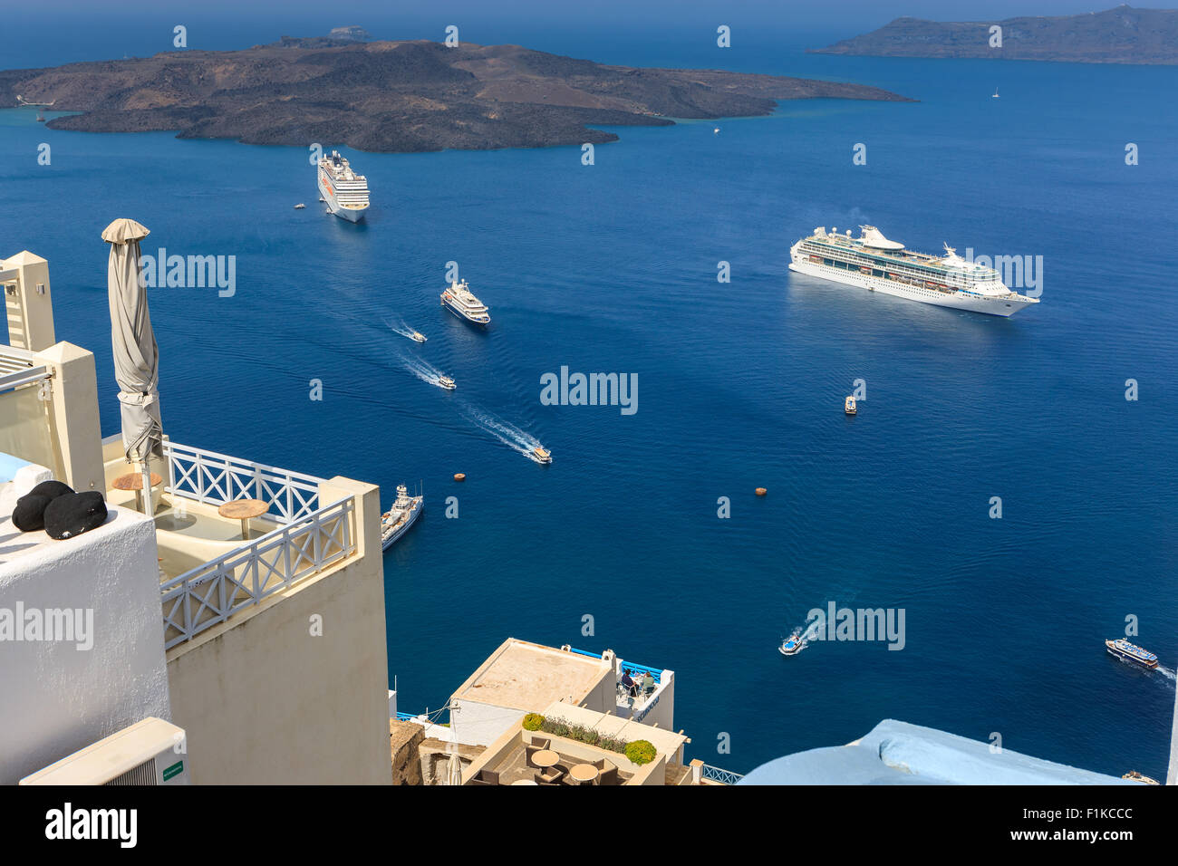 Cruise ships near Santorini, one of the Cyclades islands in Aegean Sea, Greece. - Stock Image