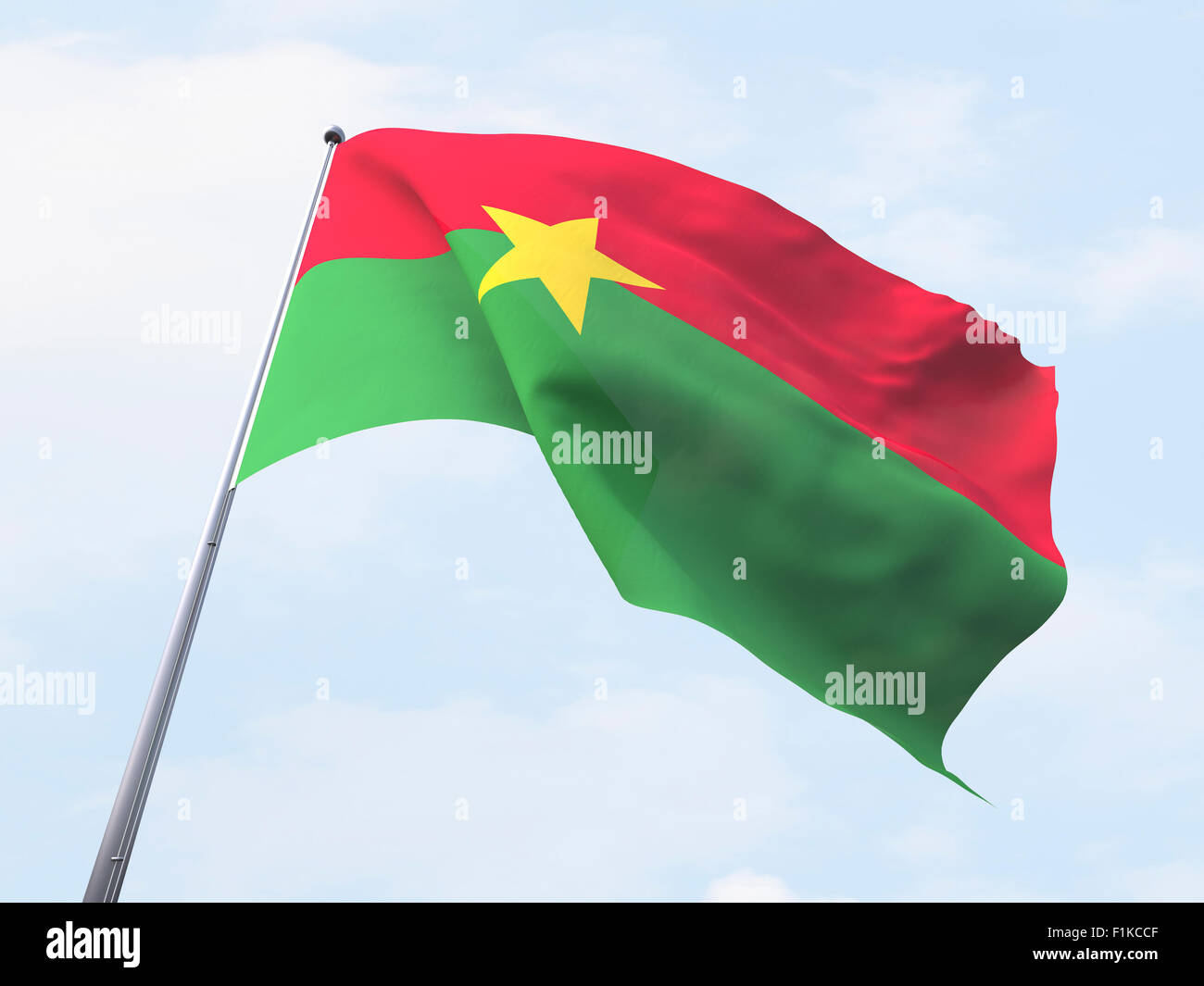 Burkina faso flag flying on clear sky. - Stock Image
