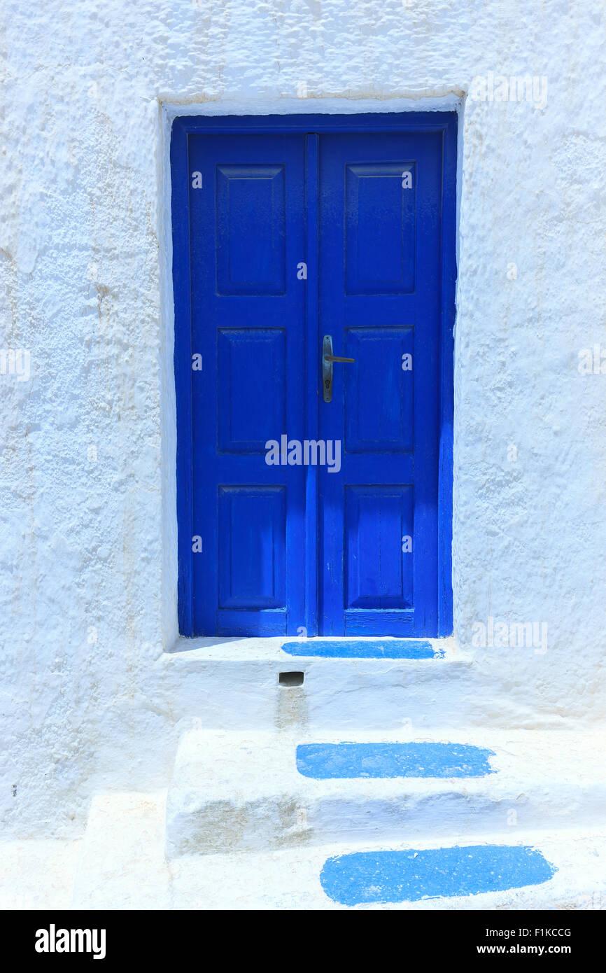 A blue frontdooron Santorini one of  Cyclades islands in Aegean Sea, Greece. - Stock Image