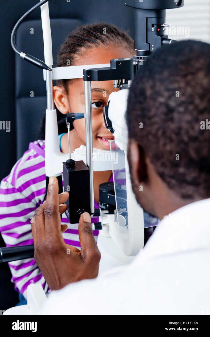A pre-teen girl having her eye examination Stock Photo