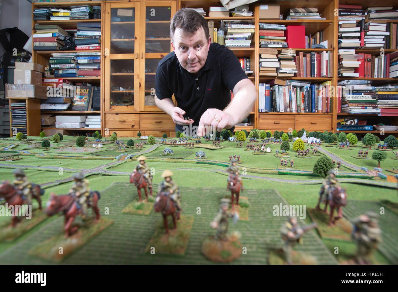 Robert Dunlop with miniature tin soldiers, recreates WW1