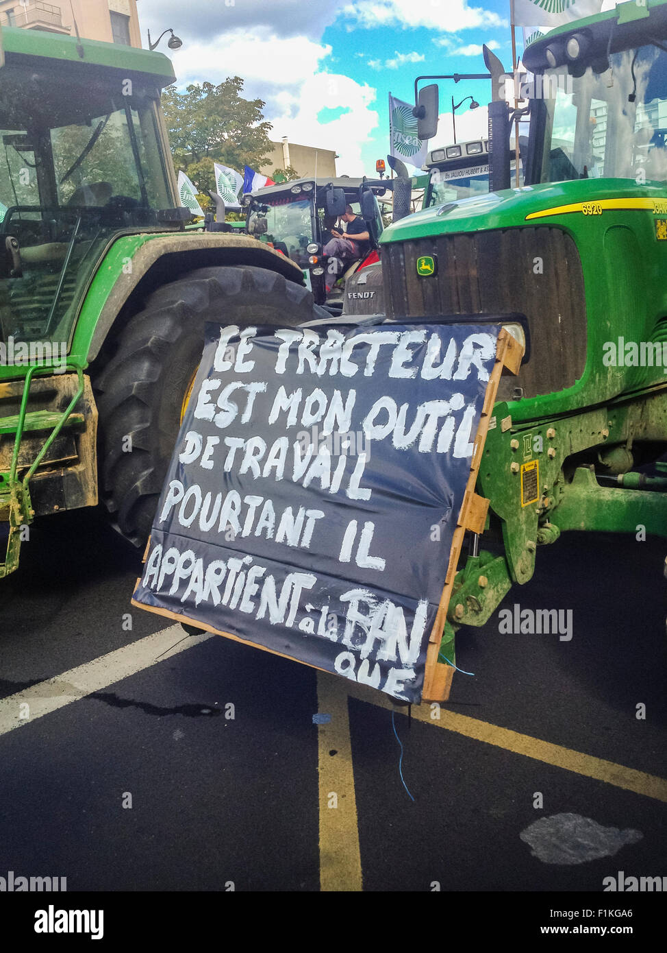 Paris, France. French Farmers Demonstration with 1000's Tractors,  French protest poster - Stock Image