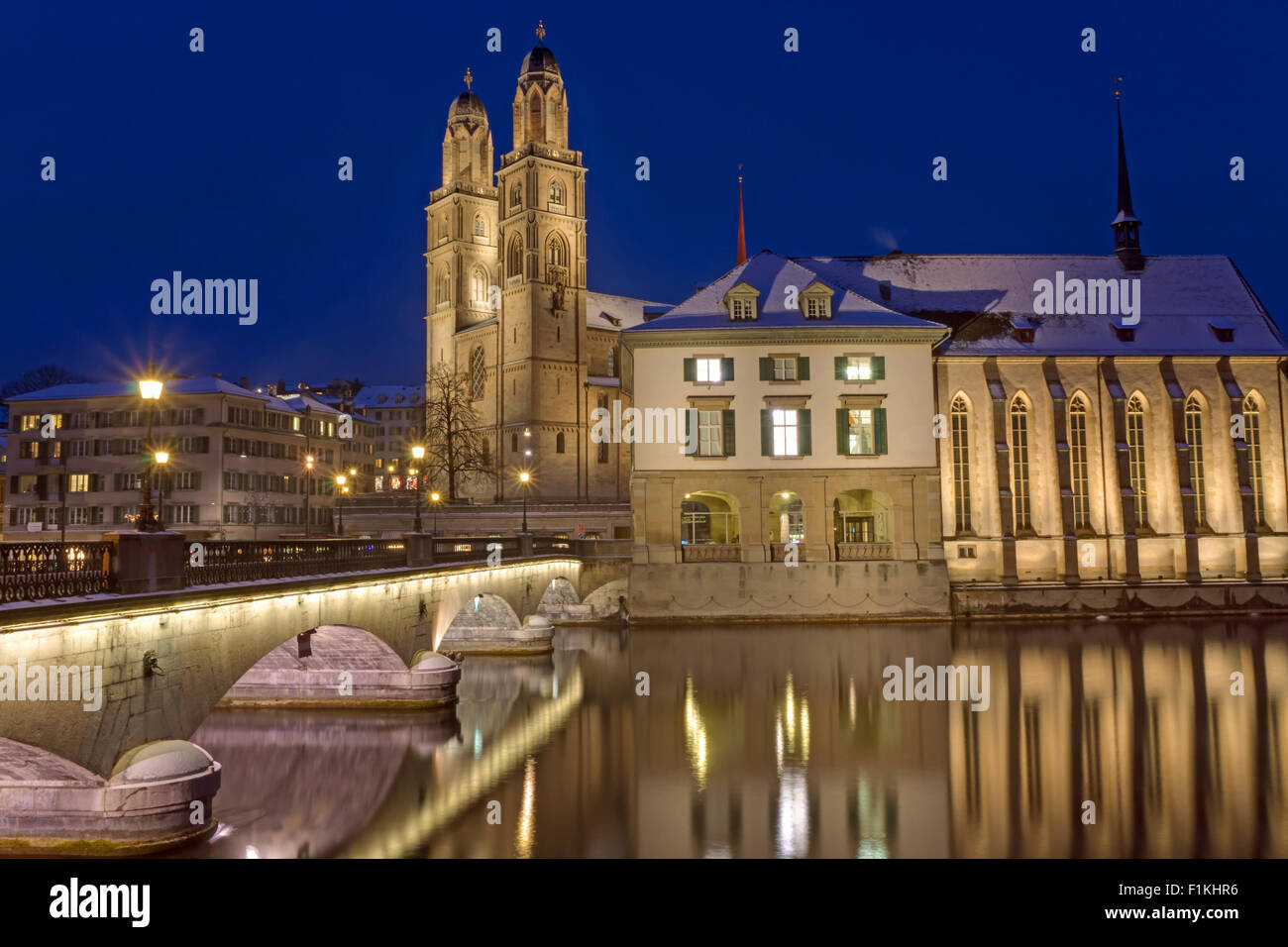 The river and the Minster in Zurich in Winter at night Stock Photo