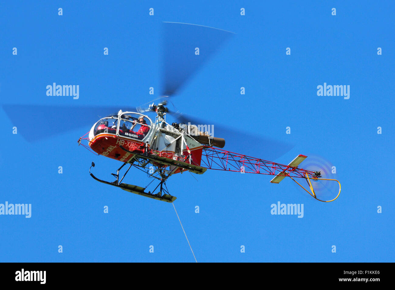 Swiss Aérospatiale SA 315B Lama rescue helicopter of Air Glaciers in flight in the Alps, Switzerland - Stock Image