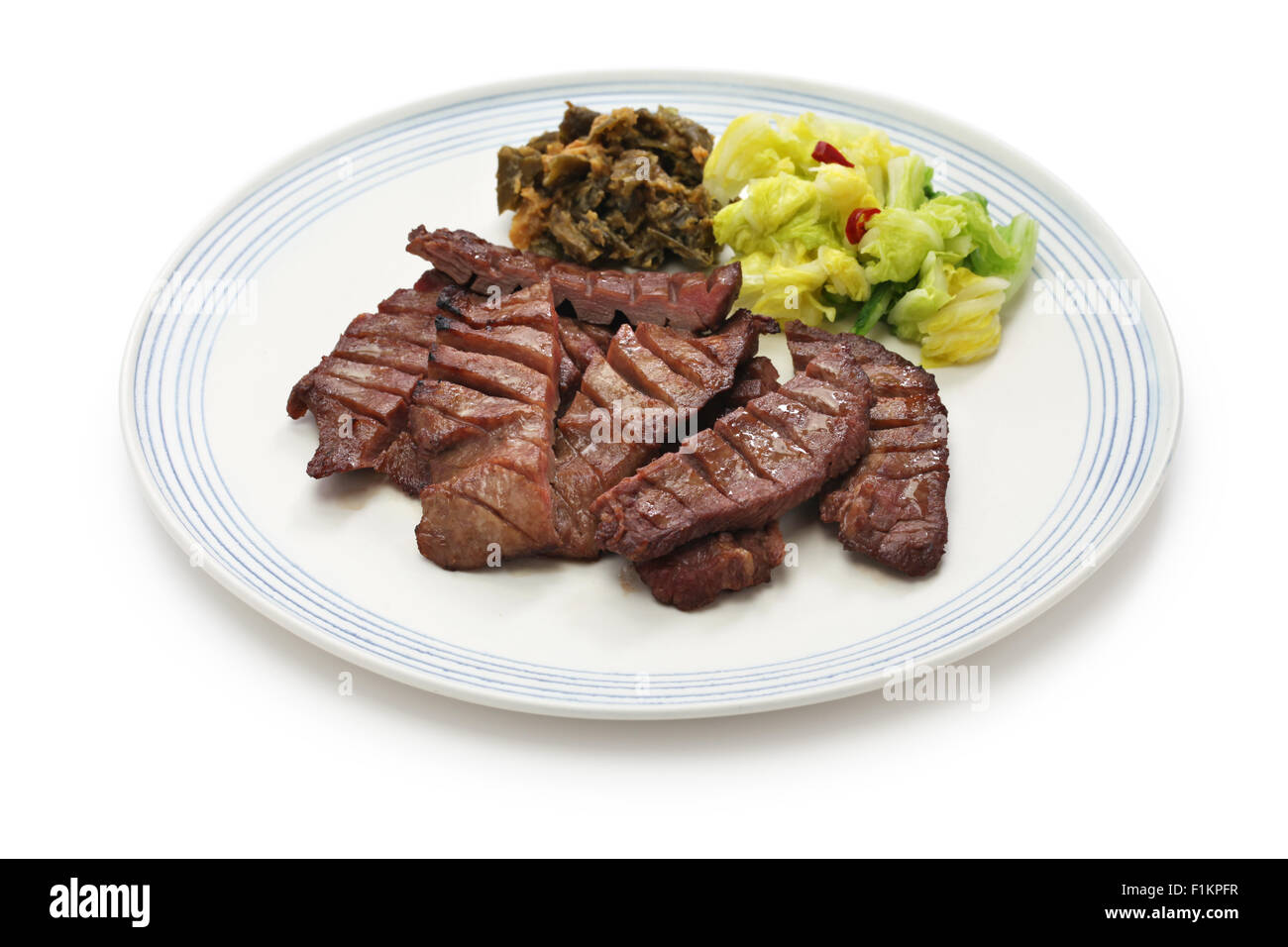 barbecue beef tongue dish, japanese food isolated on white background - Stock Image