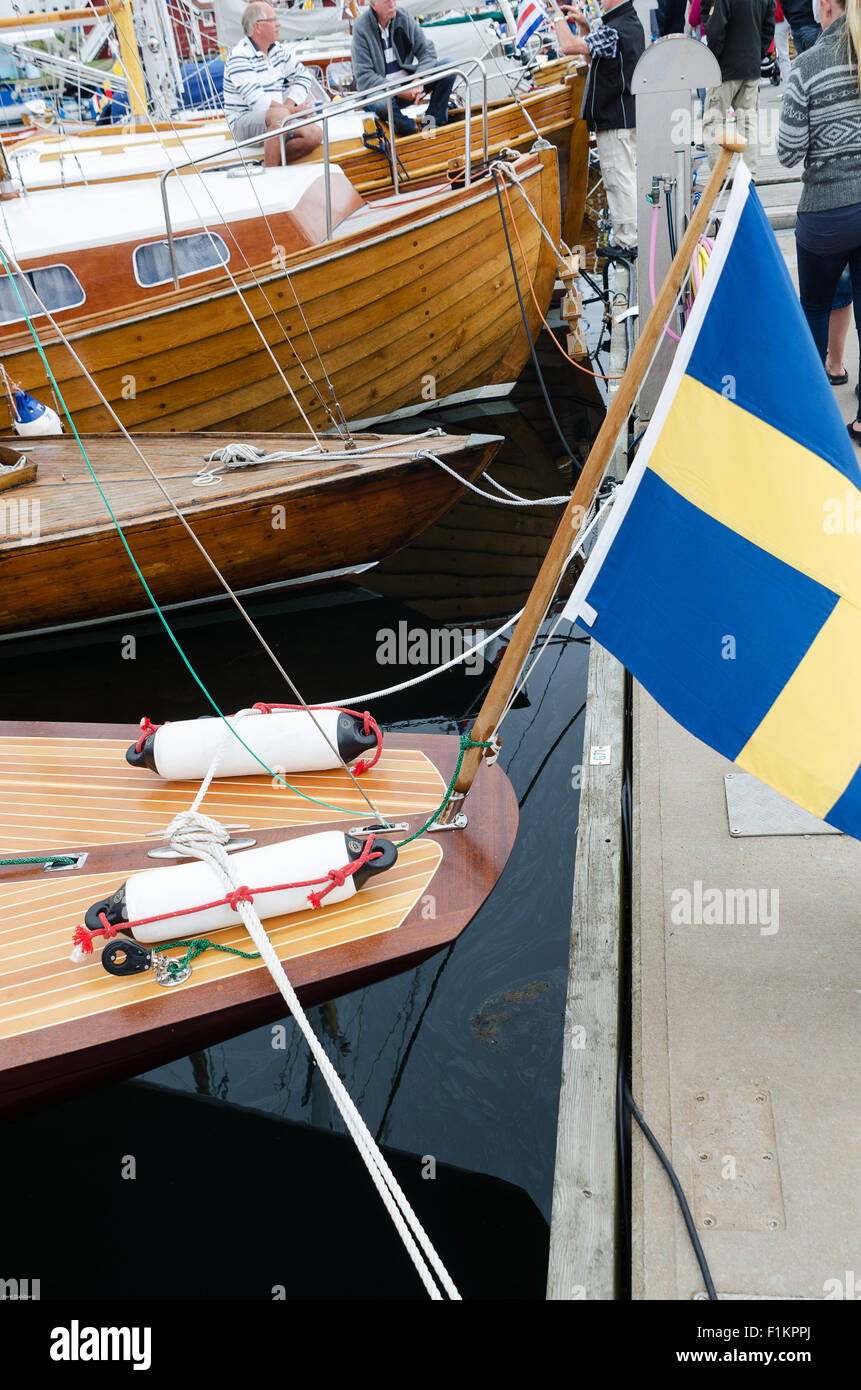 back of a beutiful and shining boat with a swedish flag - Stock Image