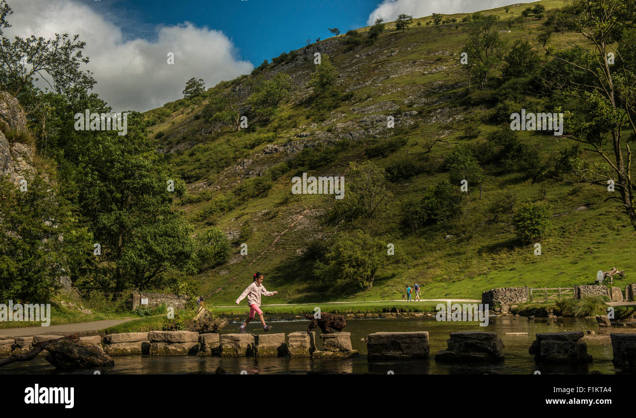 Young girl crossing Stepping Stones, Peak District, UK - Stock Image