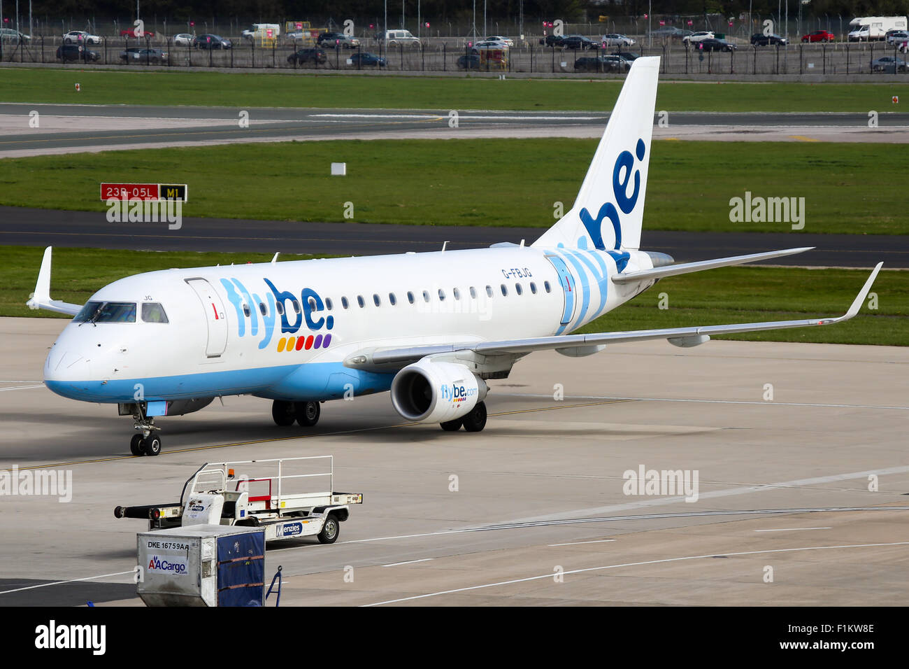 FlyBe Embraer 175 taxis onto stand at Manchester airport. - Stock Image