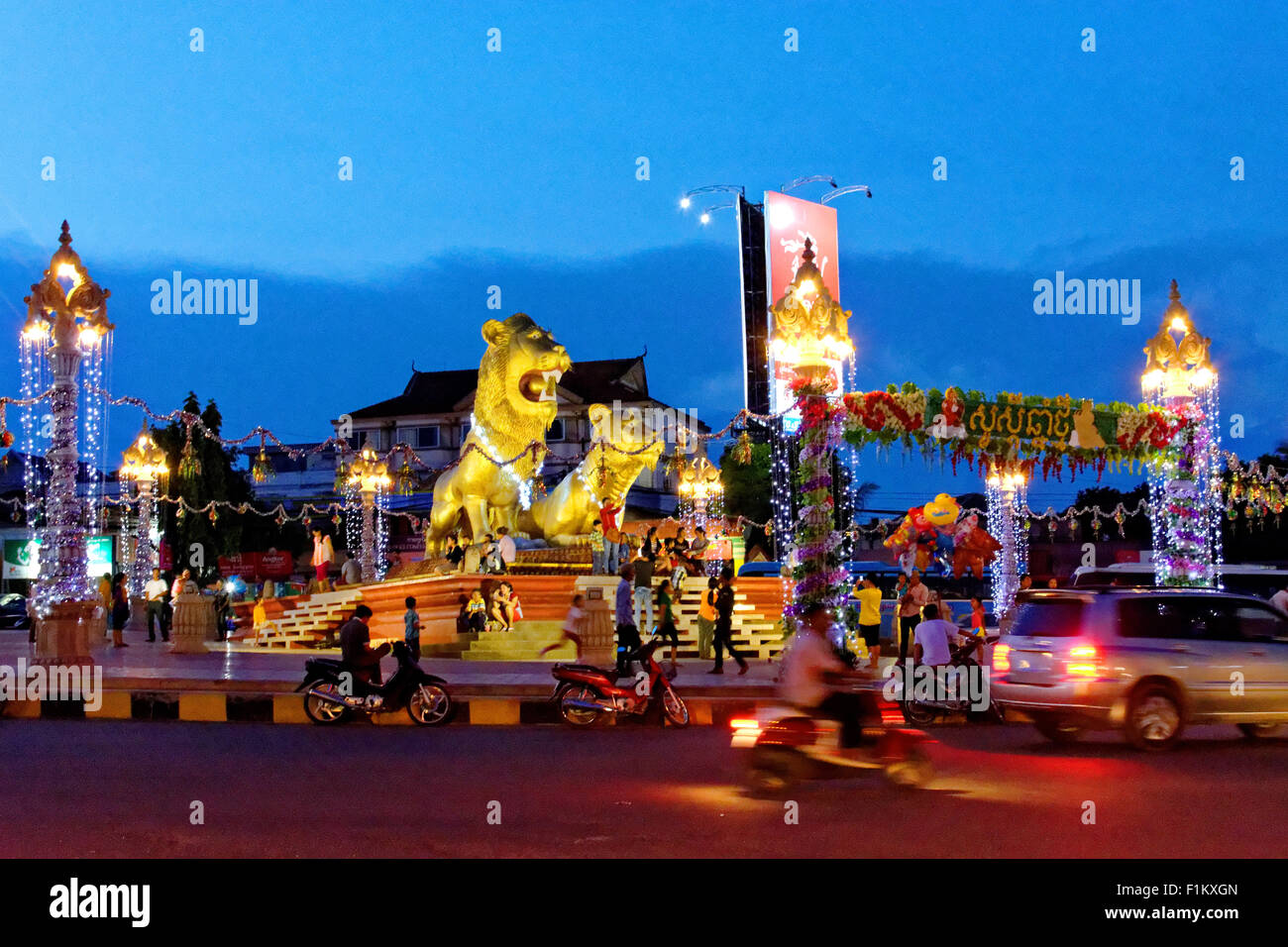 Main roundabout at night, Sihanoukville, Cambodia, white sands, blue sky, blue sea, palm huts, jogging, peaceful, - Stock Image