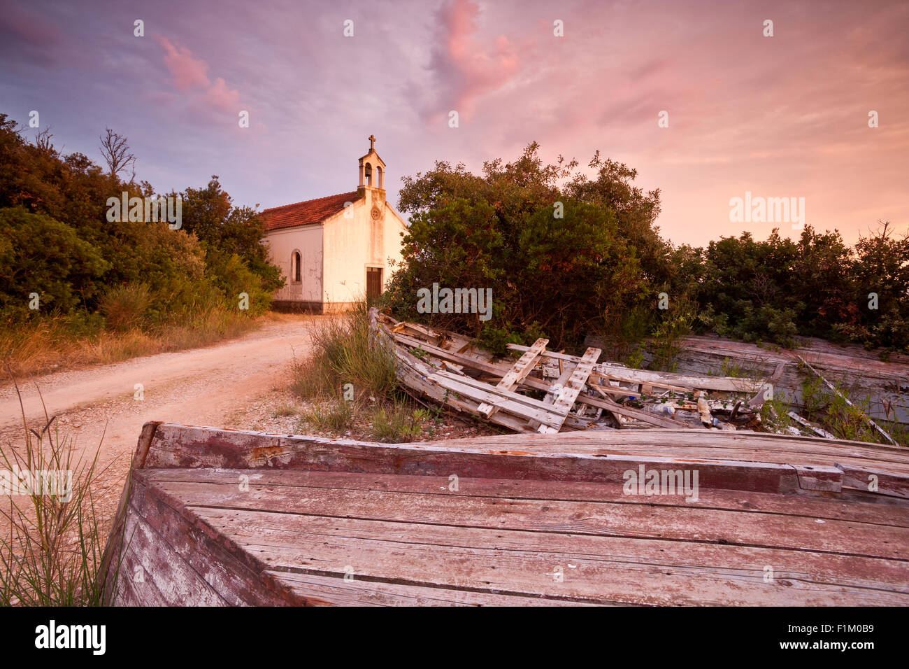 Church of Saints Cosmas and Damian in sunset, island Ugljan, Dalmatia, Croatia - Stock Image