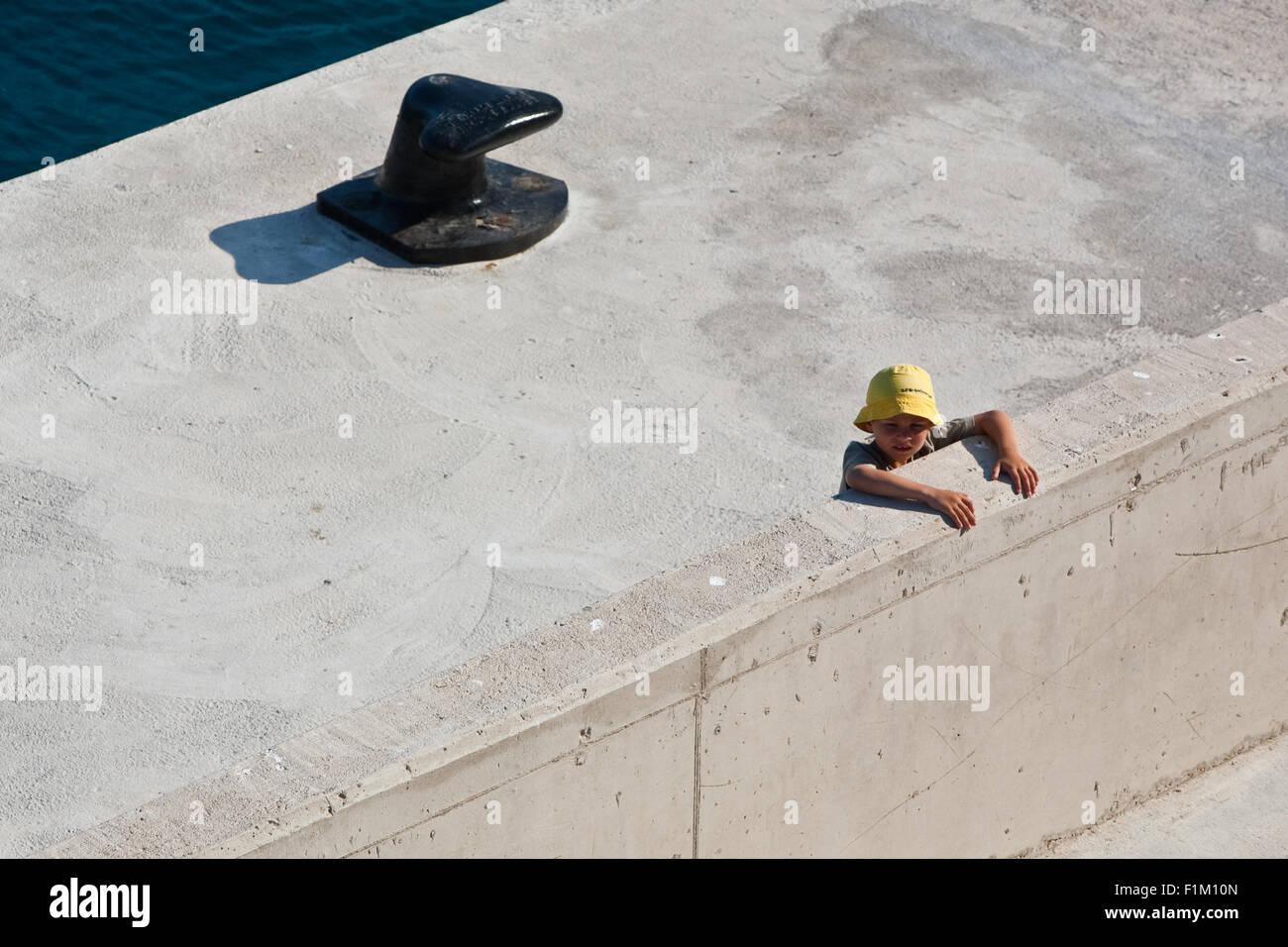 Chil waiting for the ship, Dalmatia, Croatia - Stock Image