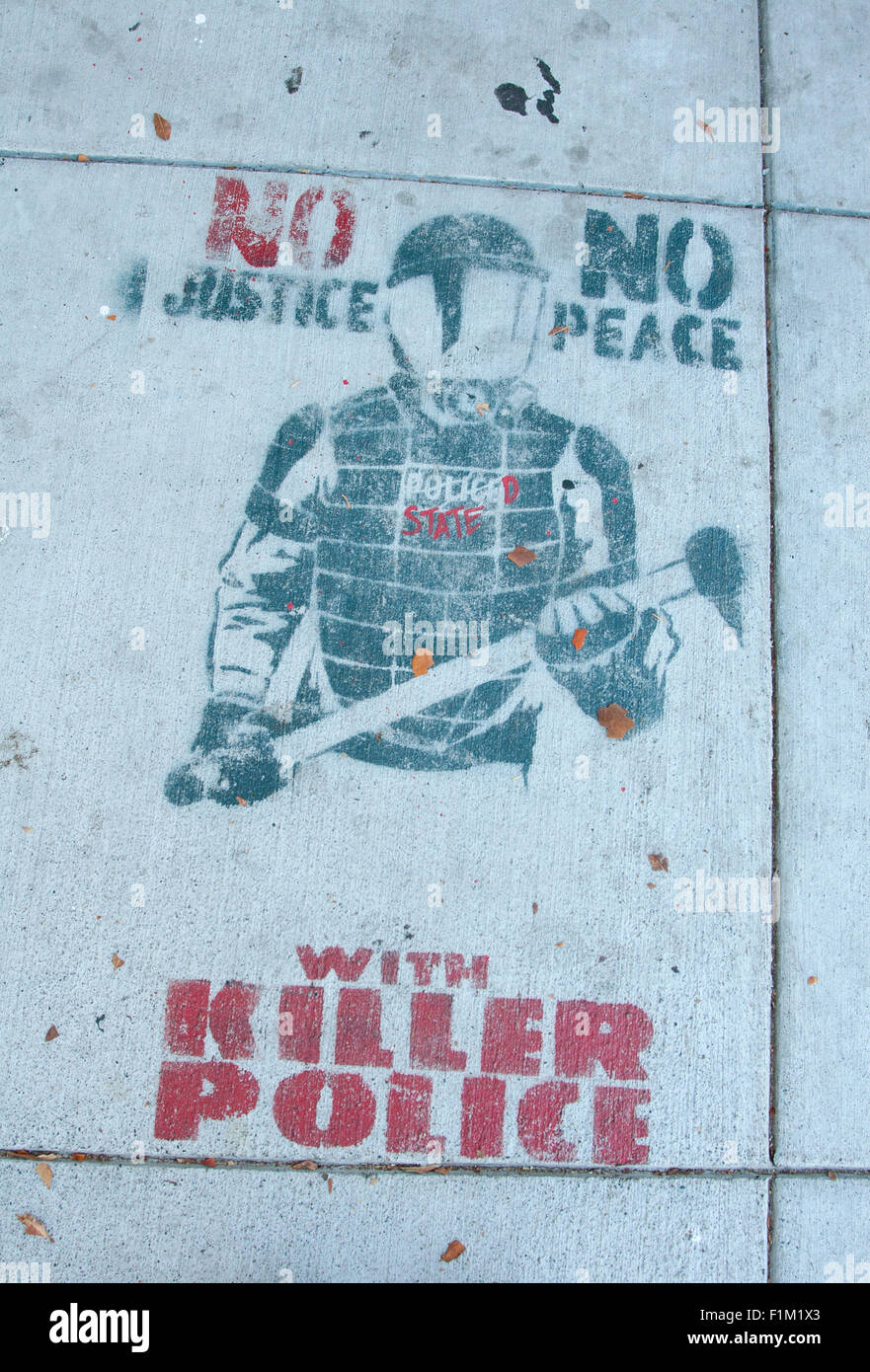 Sidewalk graffiti at 24th and Harrison in The Mission: 'No Justice, No Peace, With Killer Police' - Stock Image