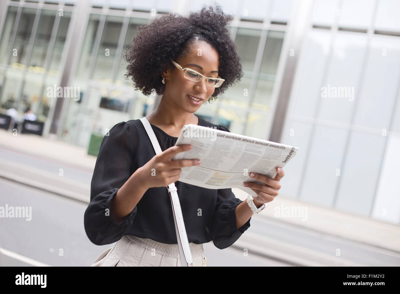 african american woman reading news stock photos & african american