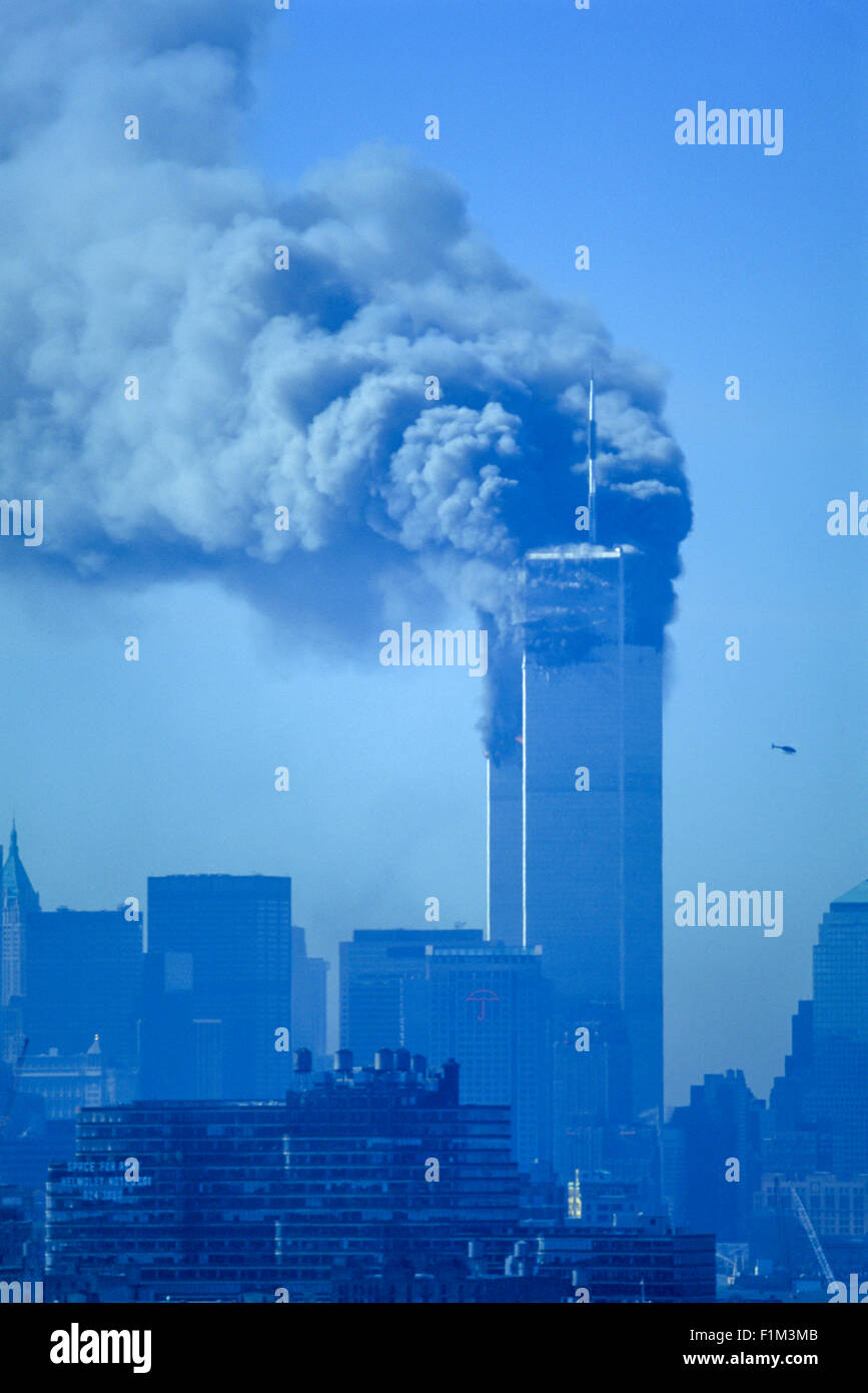 HISTORICAL SEPTEMBER 11 2001 WORLD TRADE CENTER ATTACK NEW YORK CITY USA 9.15 AM BOTH TOWERS STANDING ON FIRE - Stock Image