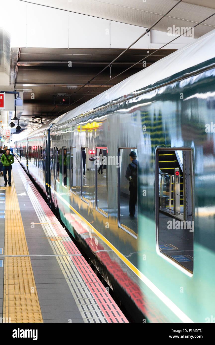Japan, JR Osaka station. Train, view along carriages of Twilight Express, at station platform - Stock Image