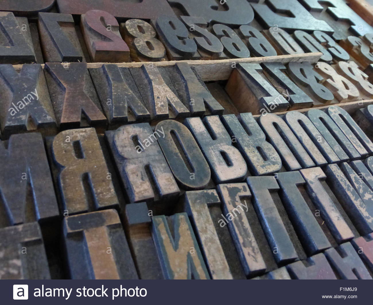 Medium Close up of large metal movable type block letters, used in printing presses prior to the digital age. - Stock Image