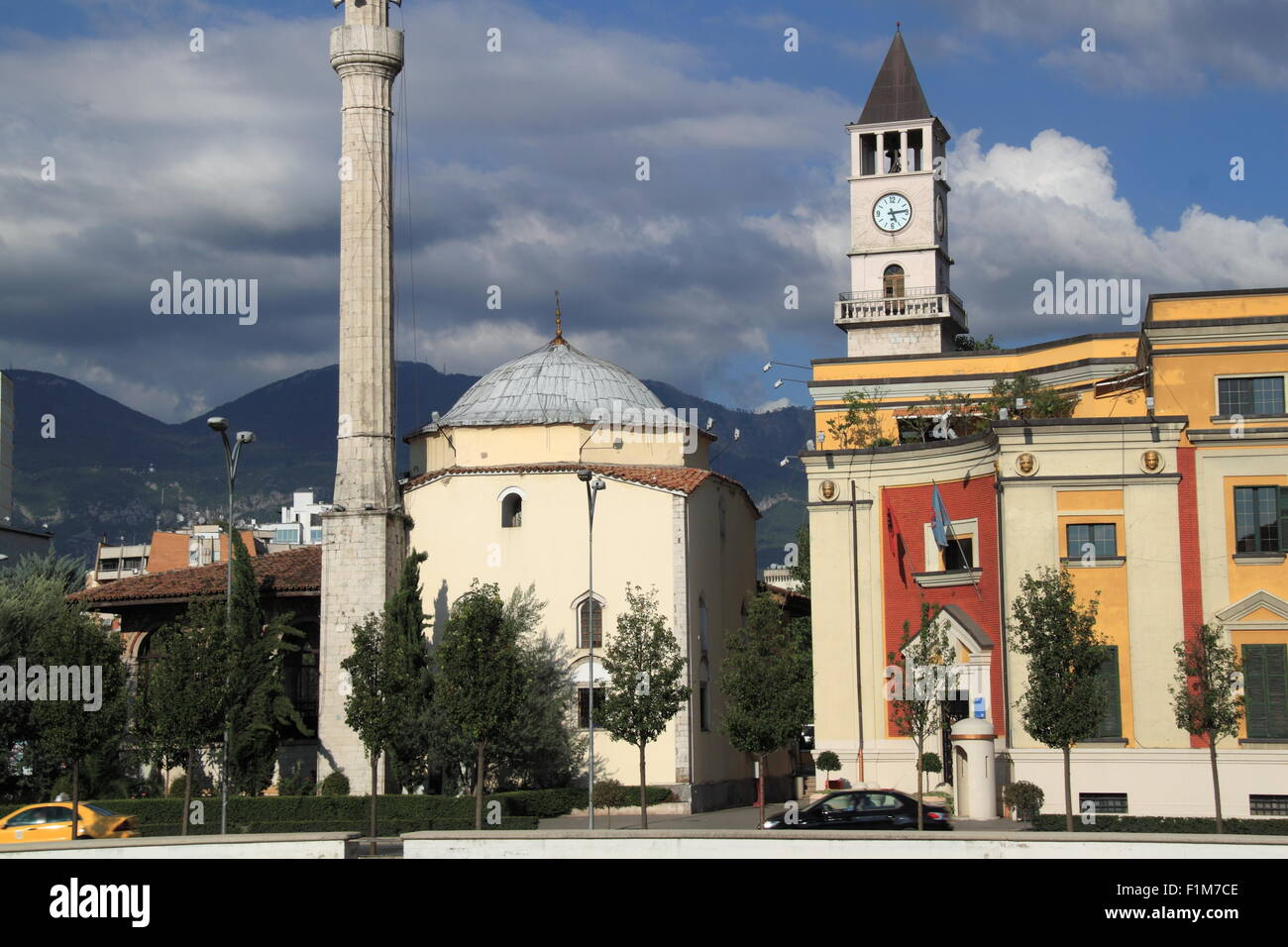 Et'hem Bey Mosque and City Hall with Clocktower behind, Skanderbeg Square, Tirana, Albania, Balkans, Europe - Stock Image