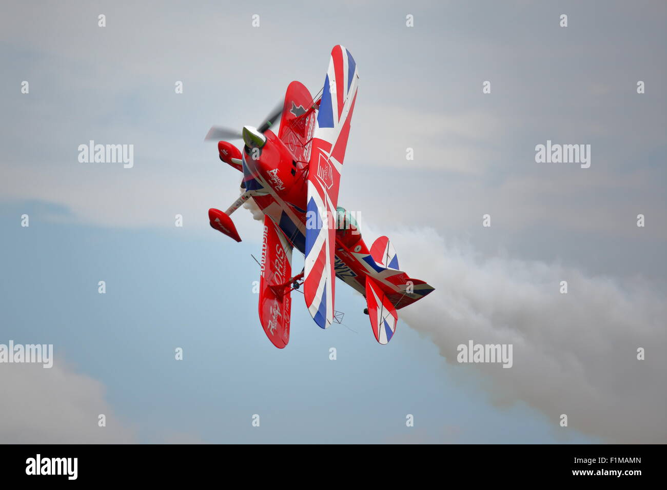 Rich Goodwin displays some extreme aerobatics at the Dunsfold Wings and Wheels Show with his Pitts Special - Stock Image