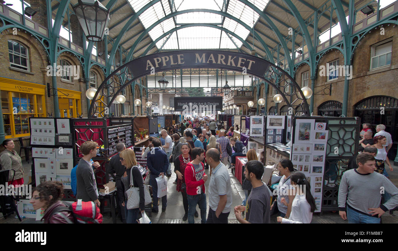 covent garden market on a busy afternoon with a croud of people