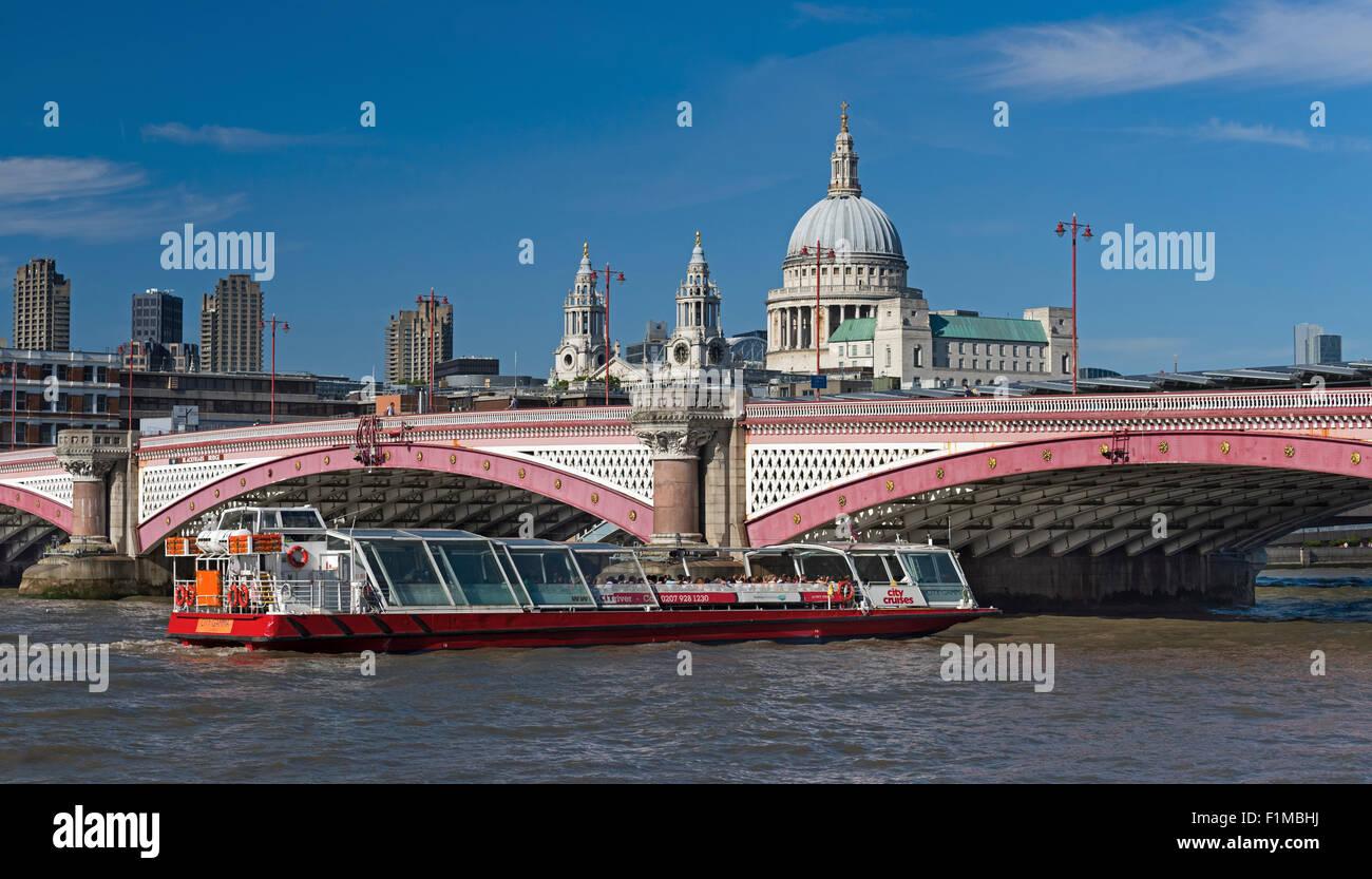 Blackfriars Bridge, St Paul's cathedral and tourist boat. London UK - Stock Image