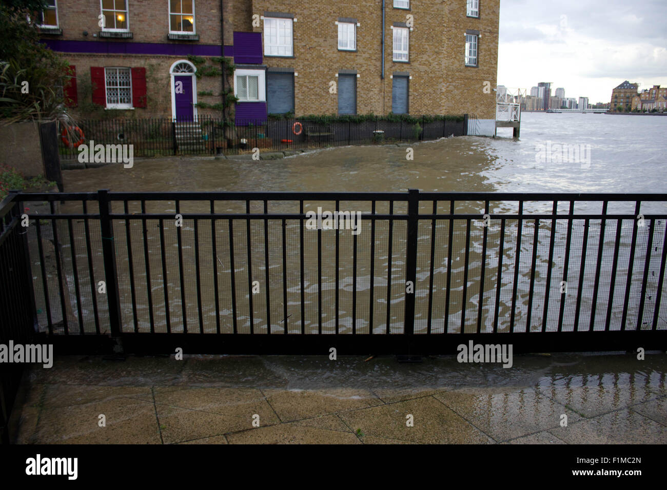 London, UK. 03rd Sep, 2015. A high tide on London's River Thames swamps walkways and edges close to doors of - Stock Image