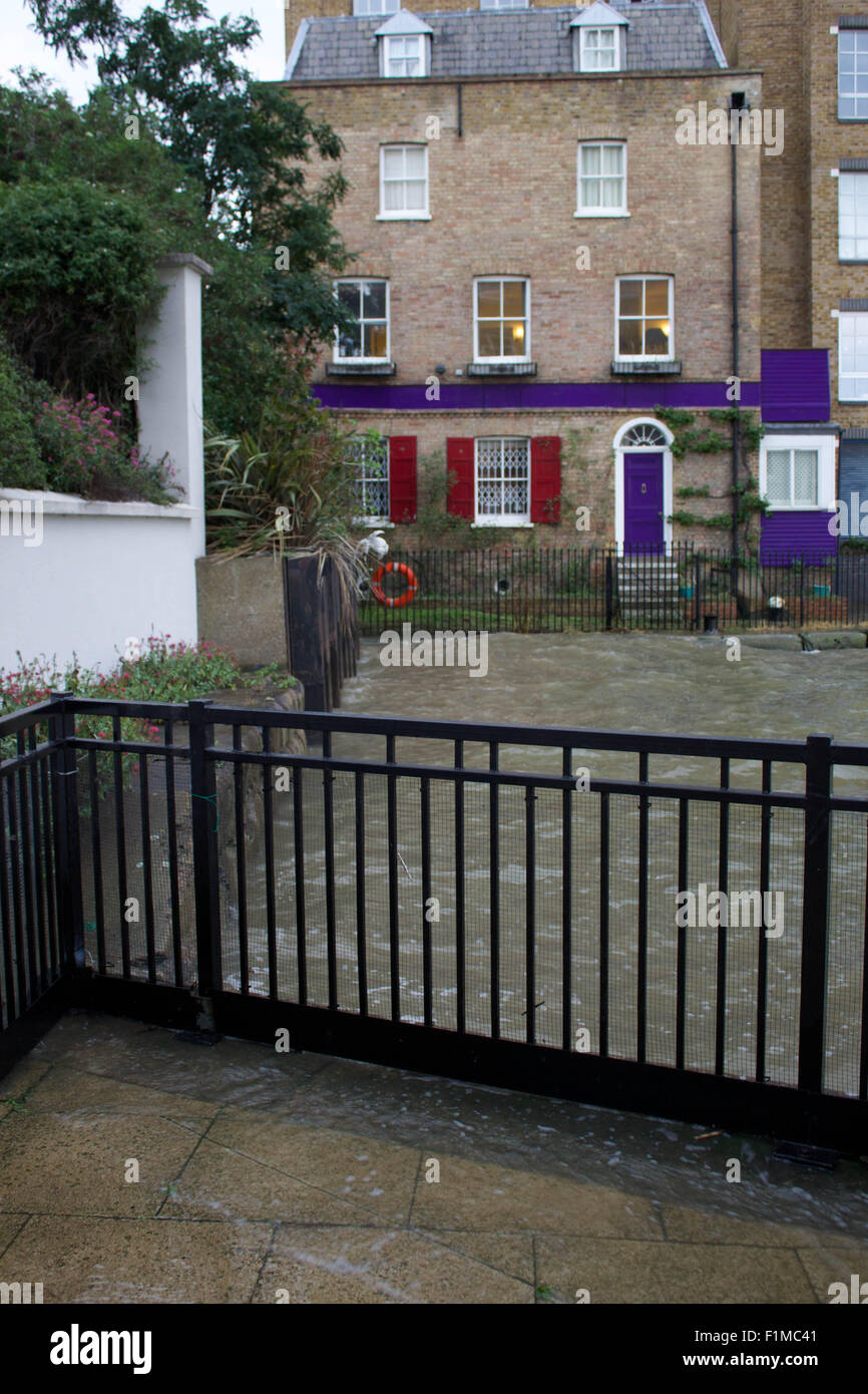 London, UK. 03rd Sep, 2015. A high tide on London's River Thames swamps walkways and edges close to doorwards - Stock Image